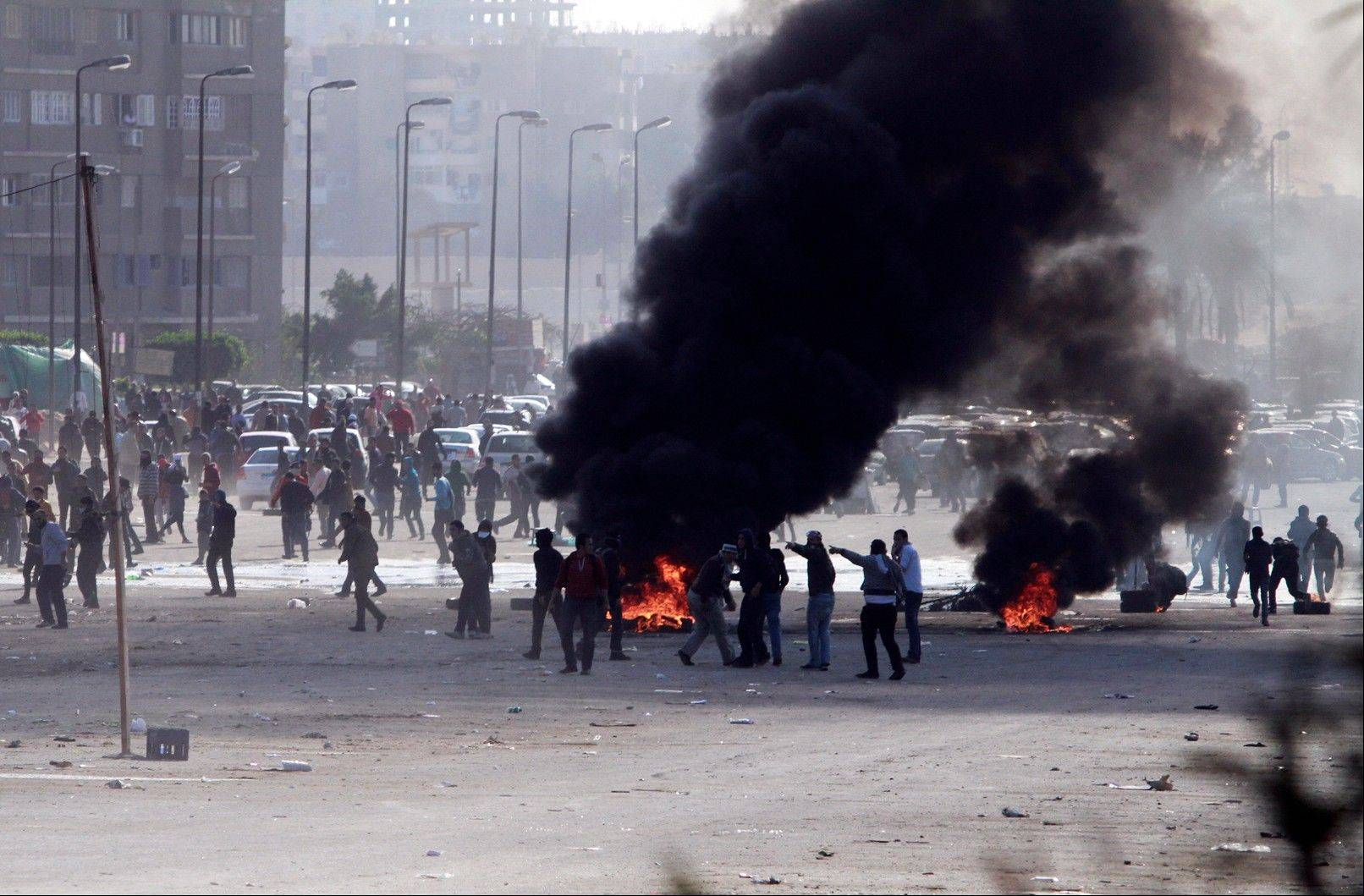 Supporters of ousted President Mohammed Morsi damage an area on a street Friday as they protest against the government in Cairo's Nasr City district.