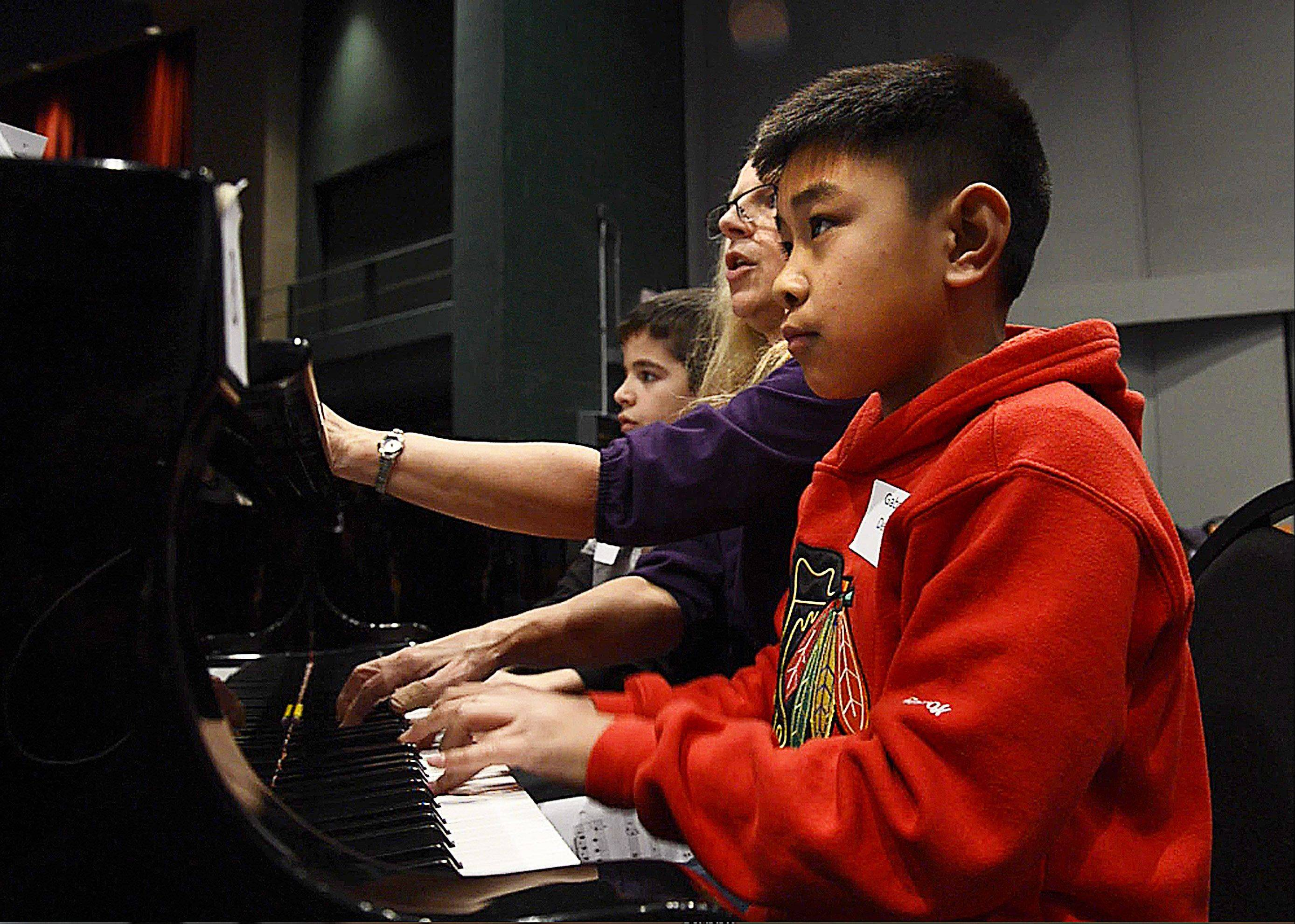 Gabriel Del Rosario, 10, is one of six cousins playing in the American Grands XIX event at the Elgin Community College's Blizzard Theater.
