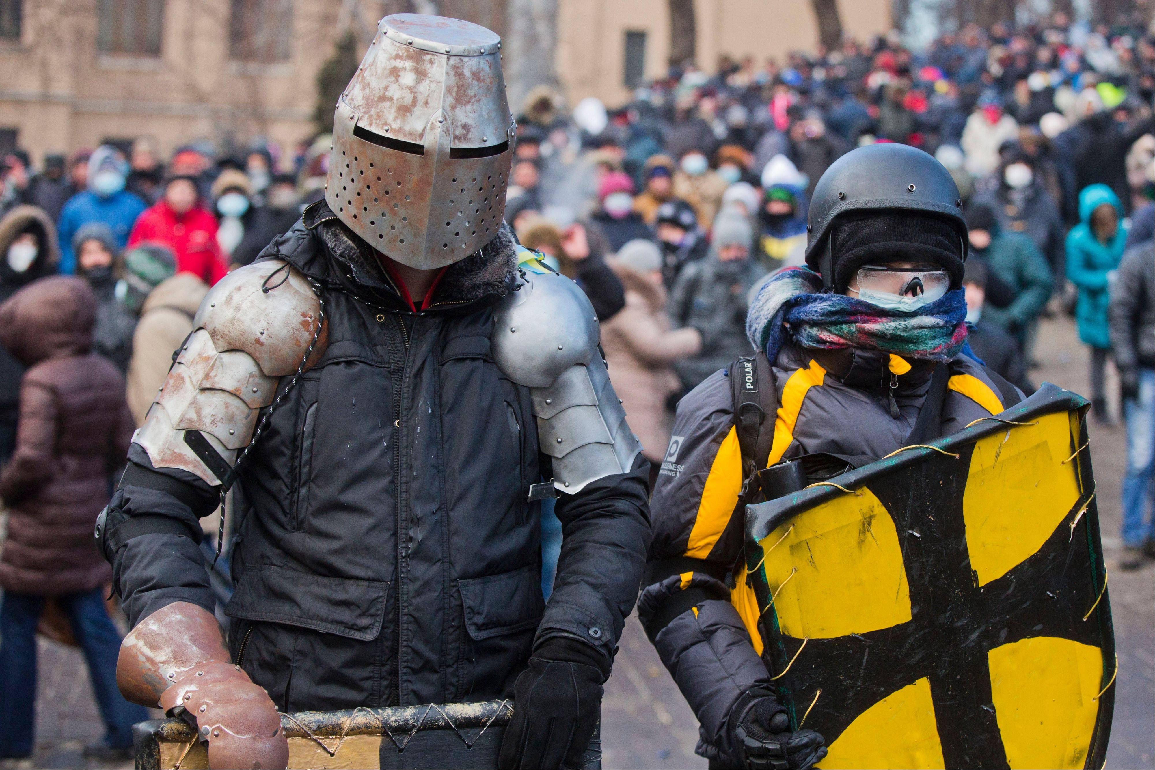 Protesters clad in improvised protective gear prepare for a clash with police in central Kiev, Ukraine.