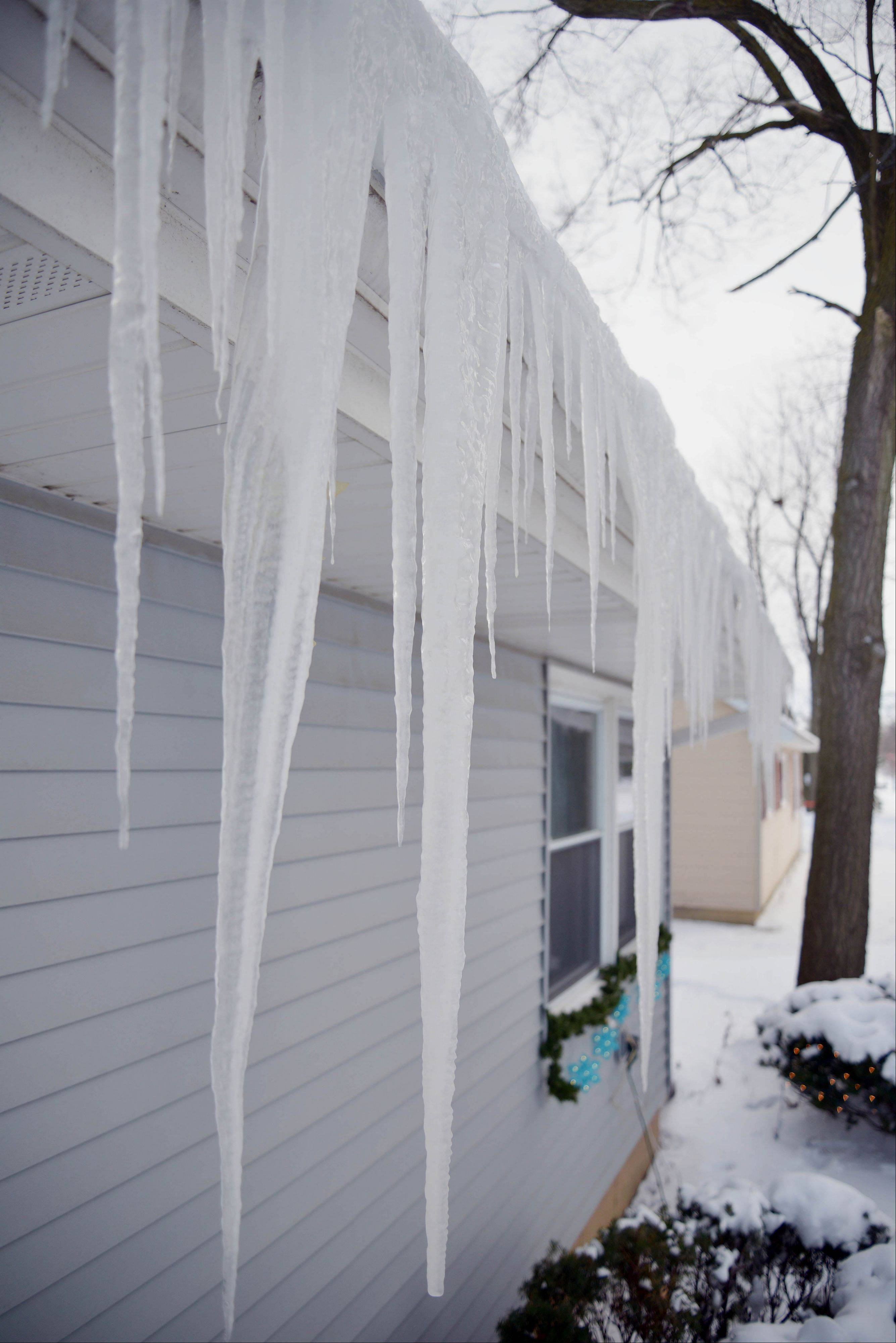 Icicles dangle from a home in Aurora.