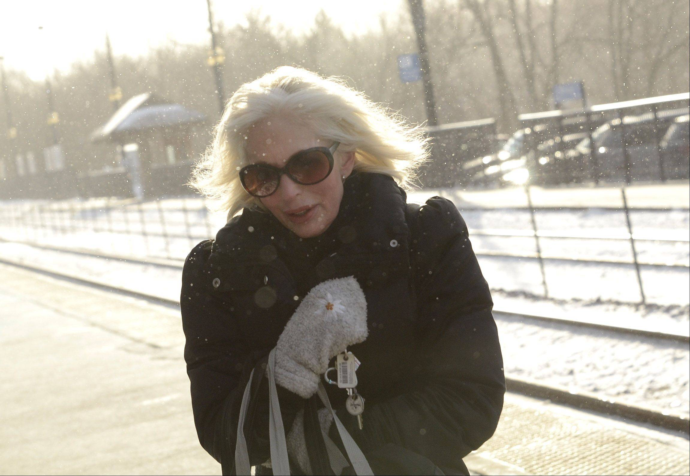 Marcia Levy of Barrington braves the cold and heads to the Barrington Metra station, on her way to Chicago to audition for a commercial Thursday morning.