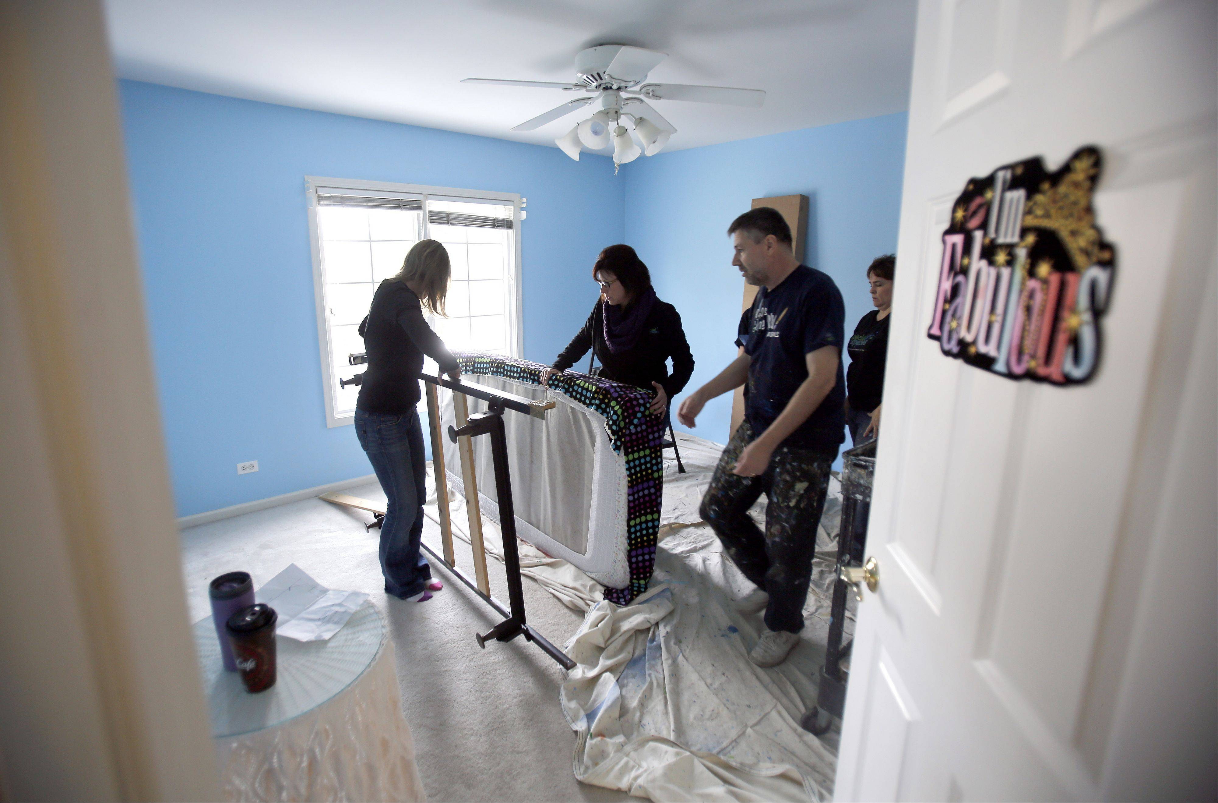Brian Hill/bhill@dailyherald.comSpecial Spaces Chicagoland, a non-profit organization that creates dream bedrooms for children with life-threatening medical conditions works on Catharine Steiner's bedroom in St. Charles Thursday. Here the crew gets started on the room.