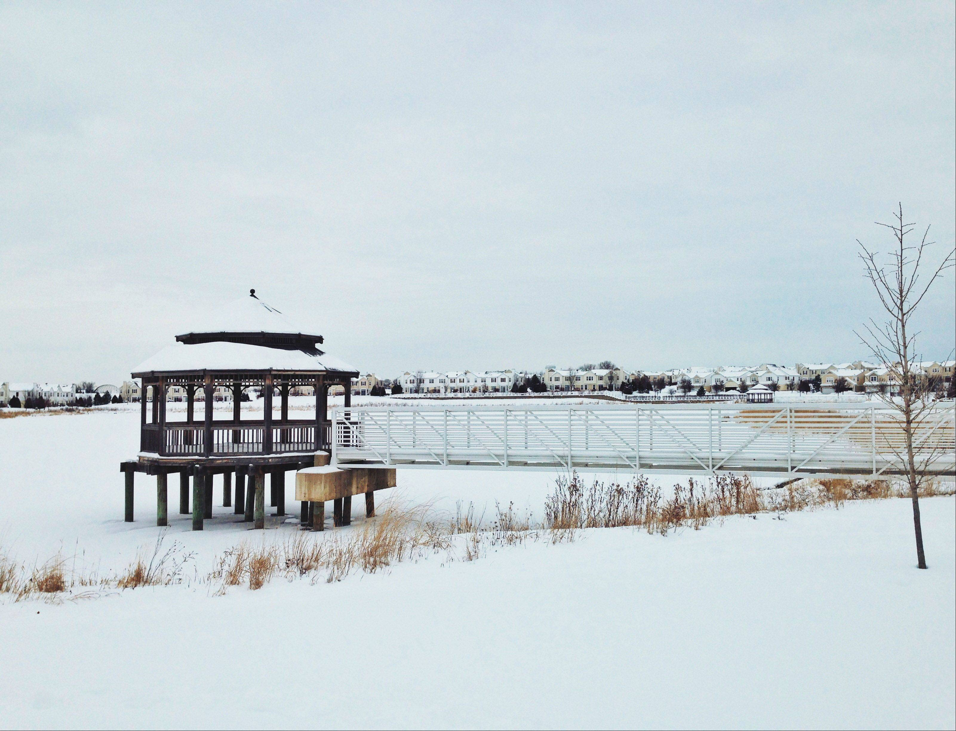 As I was passing by the lake I saw this gazebo and thought it looked just so stoic, jutting out like that over the frozen water, coated in snow in the -10 degree weather. So, I quickly parked on the side of the road and snapped a few pictures with my phone. I think it was well worth it.