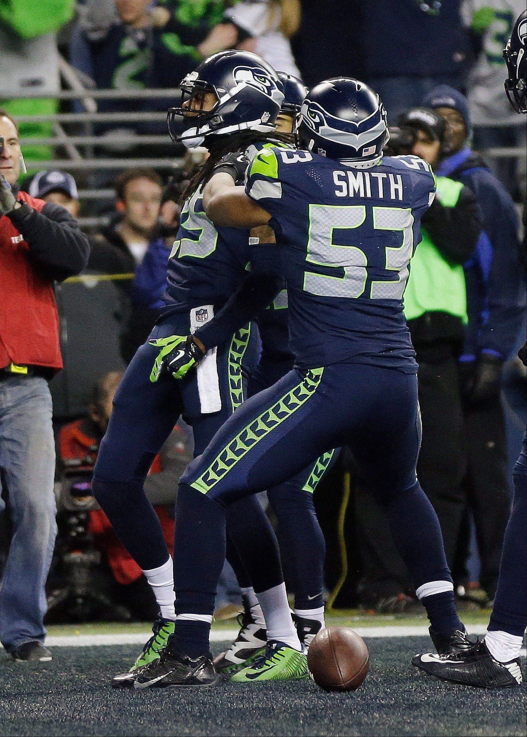 FILE - In this Sunday, Jan. 19, 2014 file photo, Seattle Seahawks' Richard Sherman reacts after tipping a pass intended for San Francisco 49ers' Michael Crabtree (15) in the final seconds of the second half of the NFL football NFC Championship game Sunday, Jan. 19, 2014, in Seattle. Seattle Seahawks cornerback Richard Sherman was fined $7,875 for unsportsmanlike conduct/taunting in the final minute of the NFC championship game against San Francisco, Friday, Jan. 24, 2014.