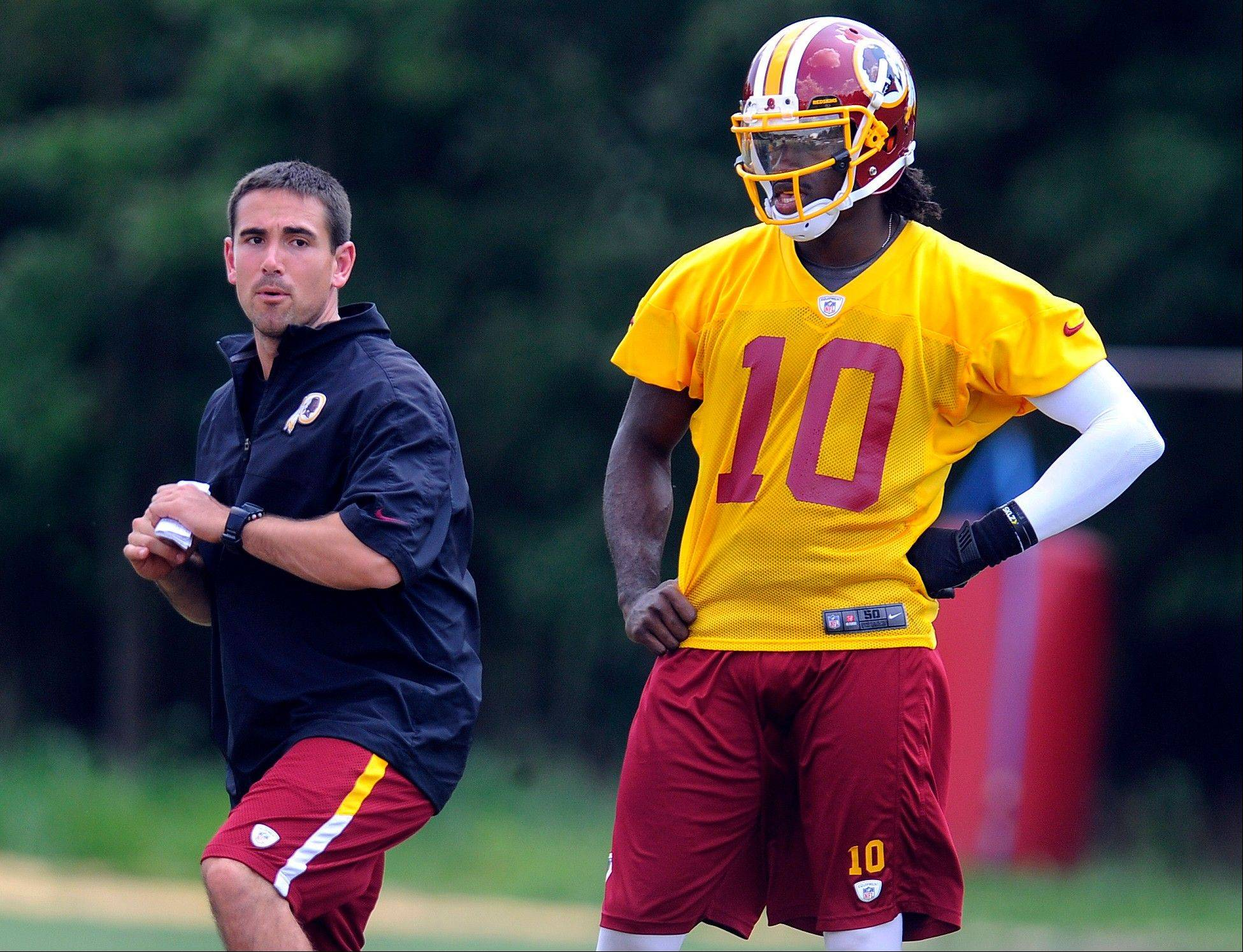 FILE - In this Aug. 16, 2012, file photo, Washington Redskins quarterback coach Matt LaFleur, left, works with quarterback Robert Griffin III during NFL football training camp in Ashburn, Va. Notre Dame head football coach Brian Kelly announced Friday, Jan. 24, 2014, that they hired LaFleur as the team's new quarterbacks coach.