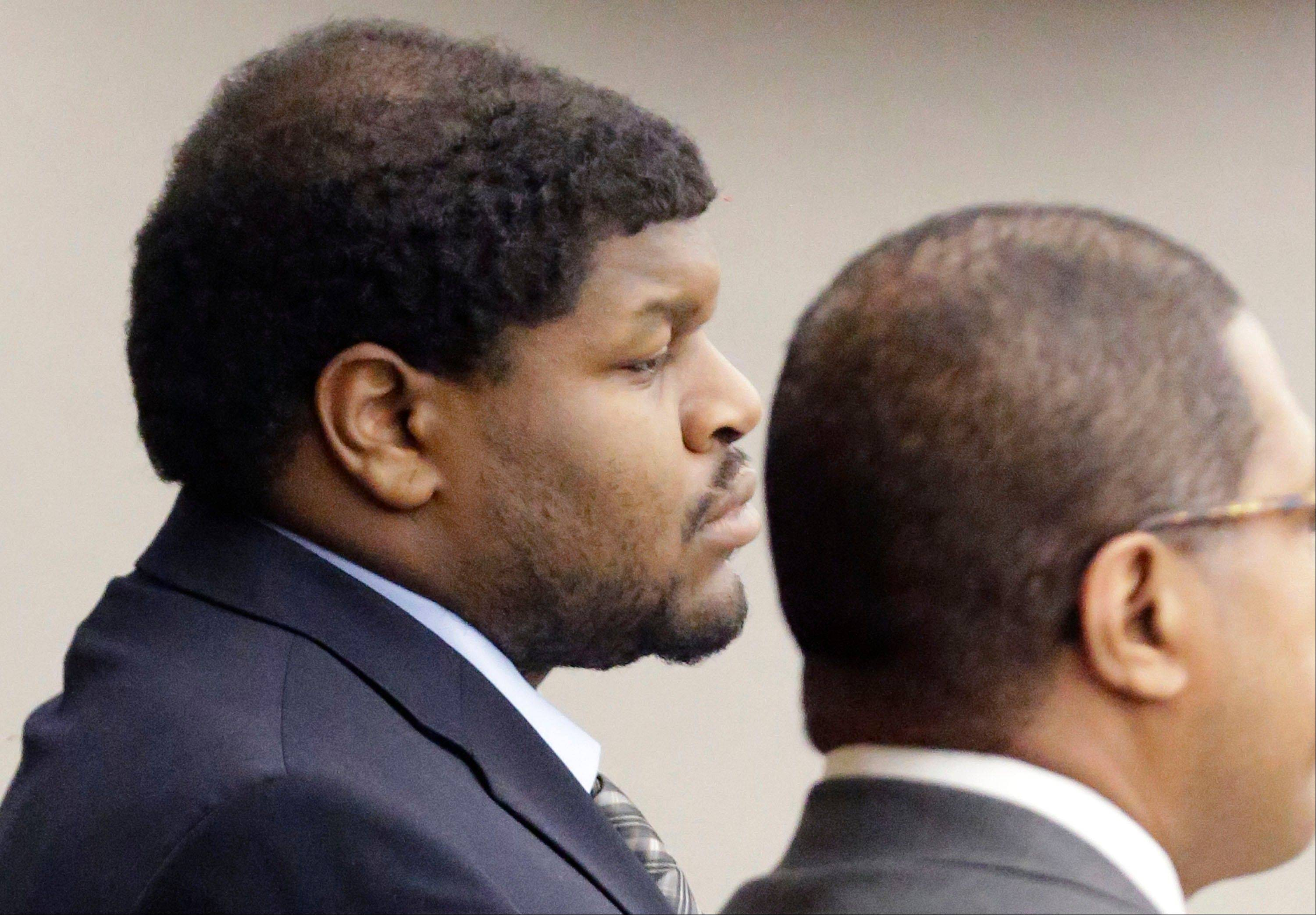 Josh Brent, left, former Dallas Cowboys NFL football player, listens with one of his lawyers Kevin Brooks while the punishment for his intoxication manslaughter conviction is read in court Friday, Jan. 24, 2014, in Dallas. Brent was sentenced to 180 days in jail and 10 years of probation for a drunken car crash that killed his friend and teammate, Jerry Brown.