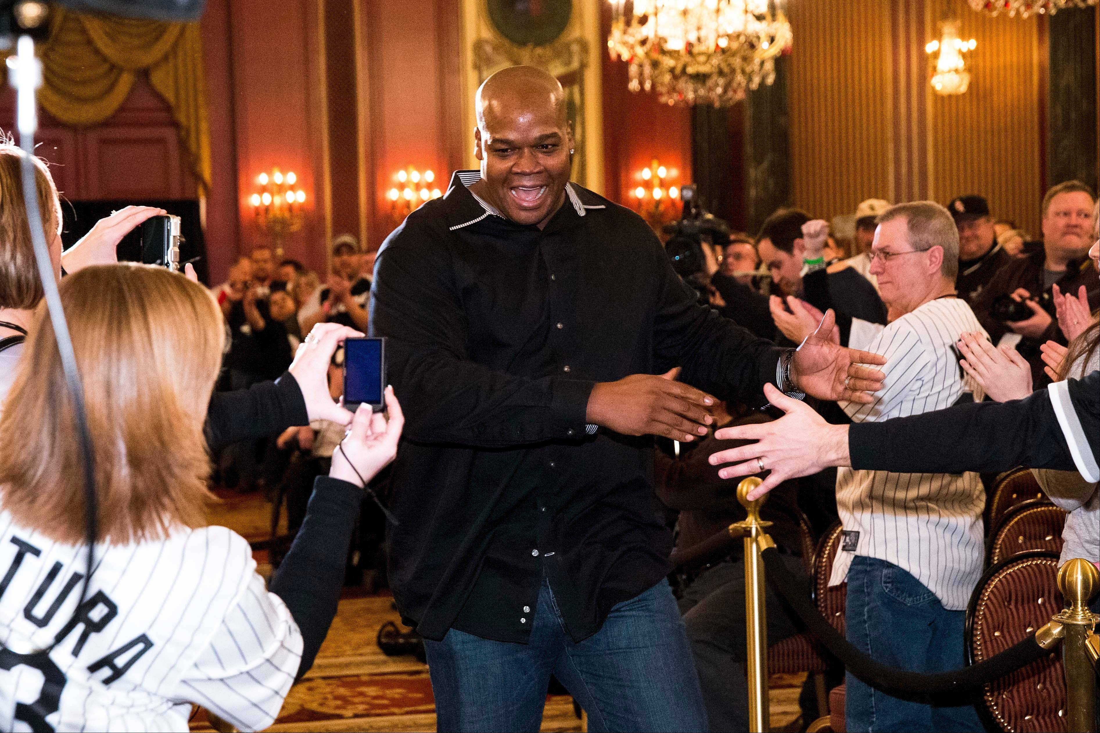 Former Chicago White Sox slugger Frank Thomas greets fans during the opening ceremony of the baseball team's SoxFest annual fan convention Friday in Chicago.