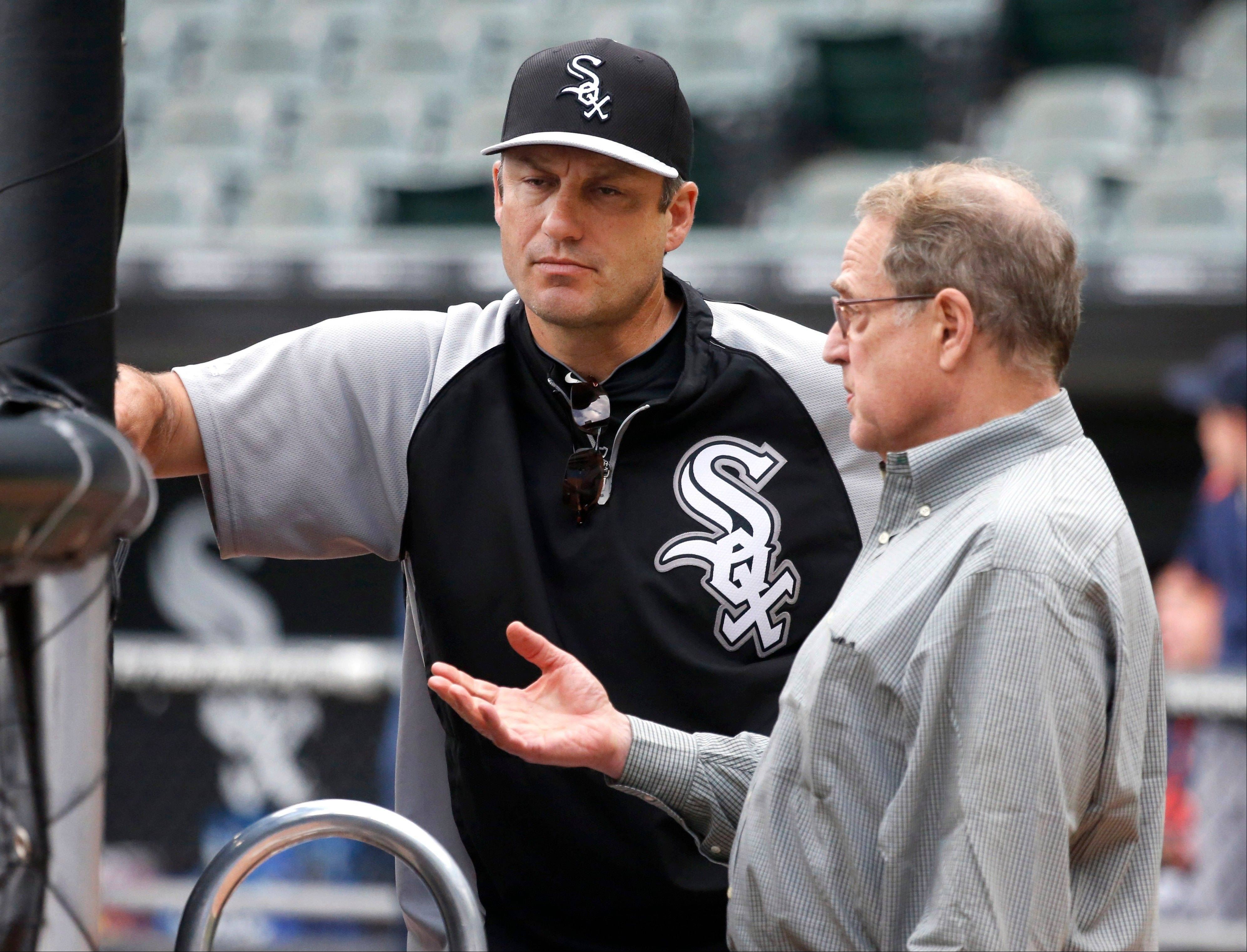 Chicago White Sox manager Robin Ventura, left, listens to club chairman Jerry Reinsdorf during batting practice before the White Sox's baseball game against the Detroit Tigers on Tuesday, July 23, 2013, in Chicago.
