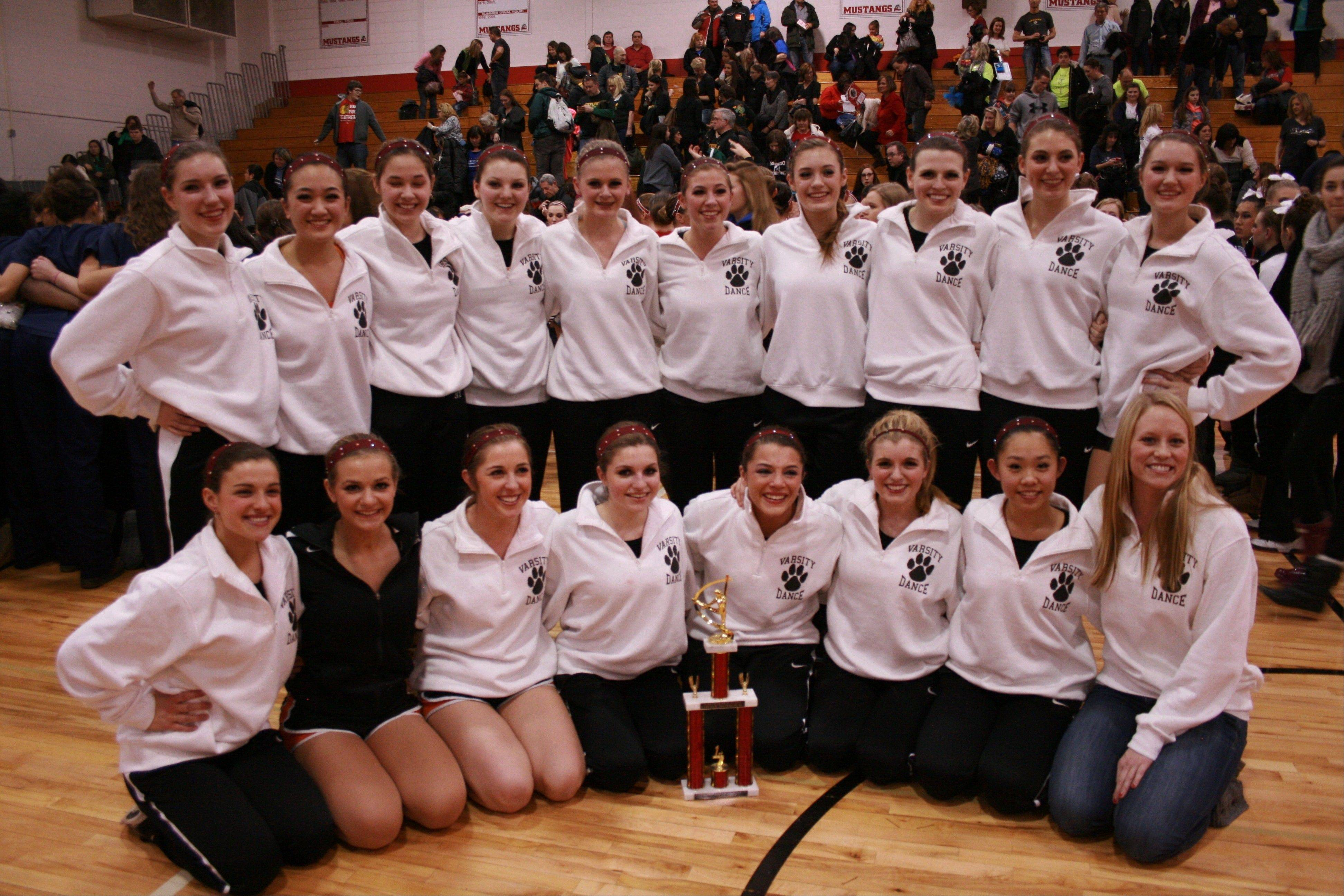 The Libertyville High School Varsity Dance Team took first place in their with their jazz routine in their division at the Mundelein Invitational and third place with their poms routine in the North Suburban Conference's first dance competition.