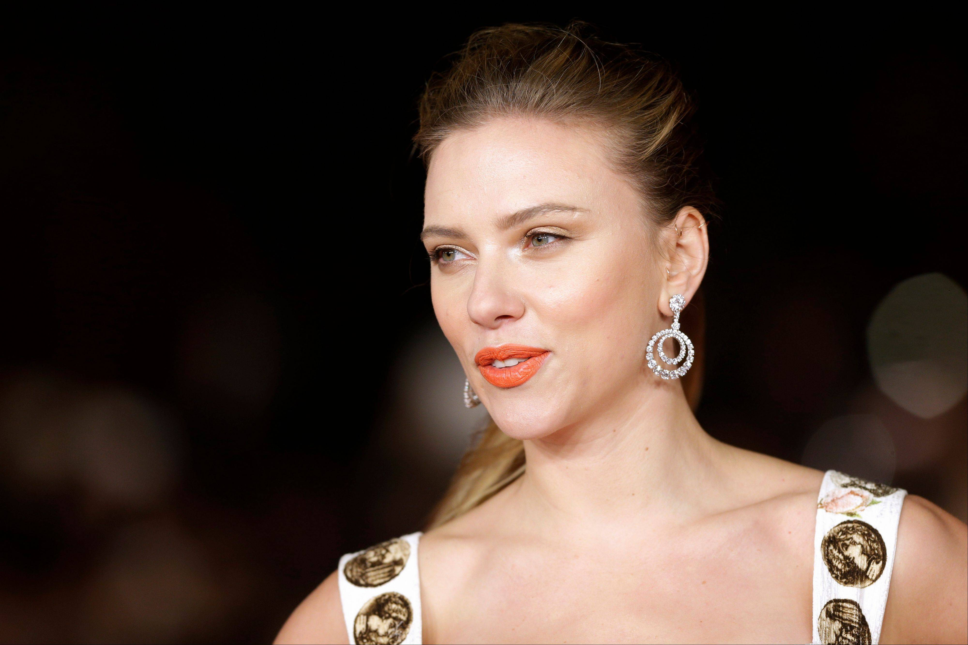Scarlett Johansson arrives for the screening of the film 'Her' at the 8th edition of the Rome International Film Festival in Rome.