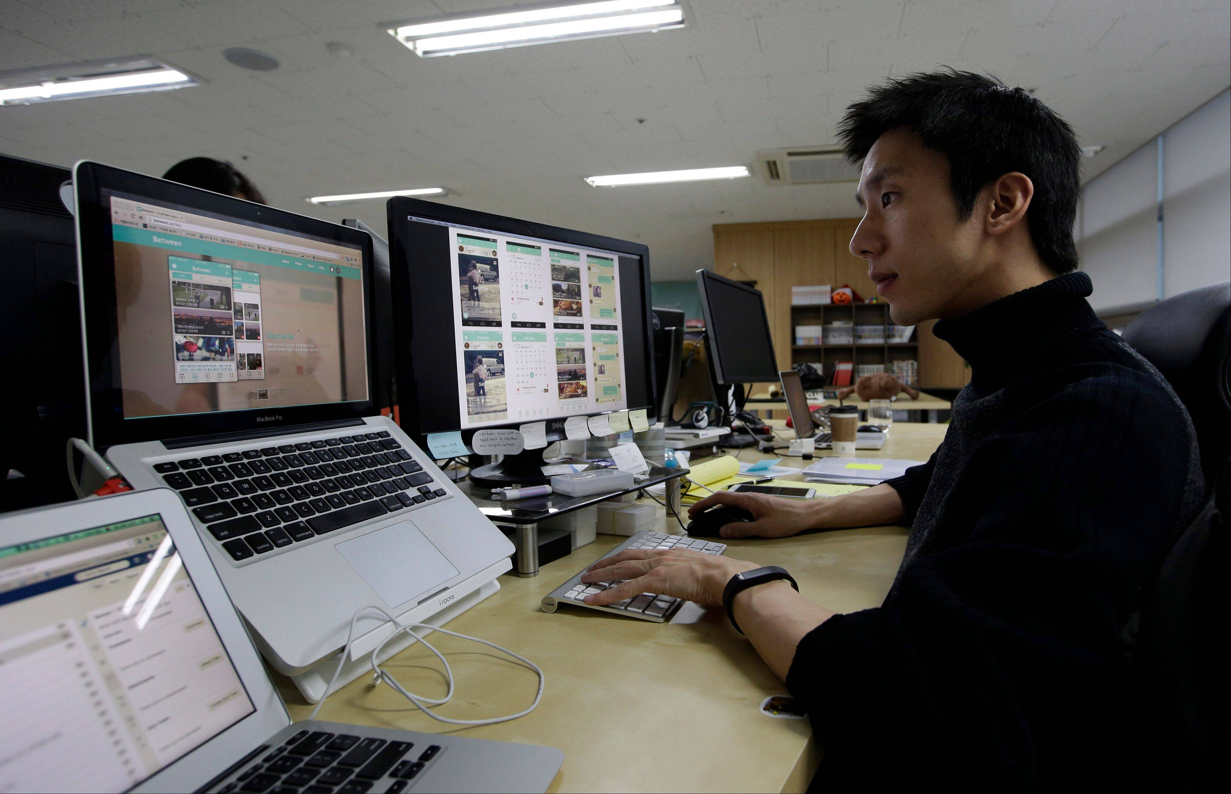 Value Creators & Company CEO Park Jaeuk shows his company's app Between on a screen at his office in Seoul, South Korea. Created by the Seoul-based startup, Between hit 5 million downloads in two years. About two-thirds of the users are in South Korea with their average age in the mid-20s. Between has attracted more than half a million users in Japan and is expanding in Thailand and Singapore. Hundreds of thousands of Chinese and American couples have also joined.