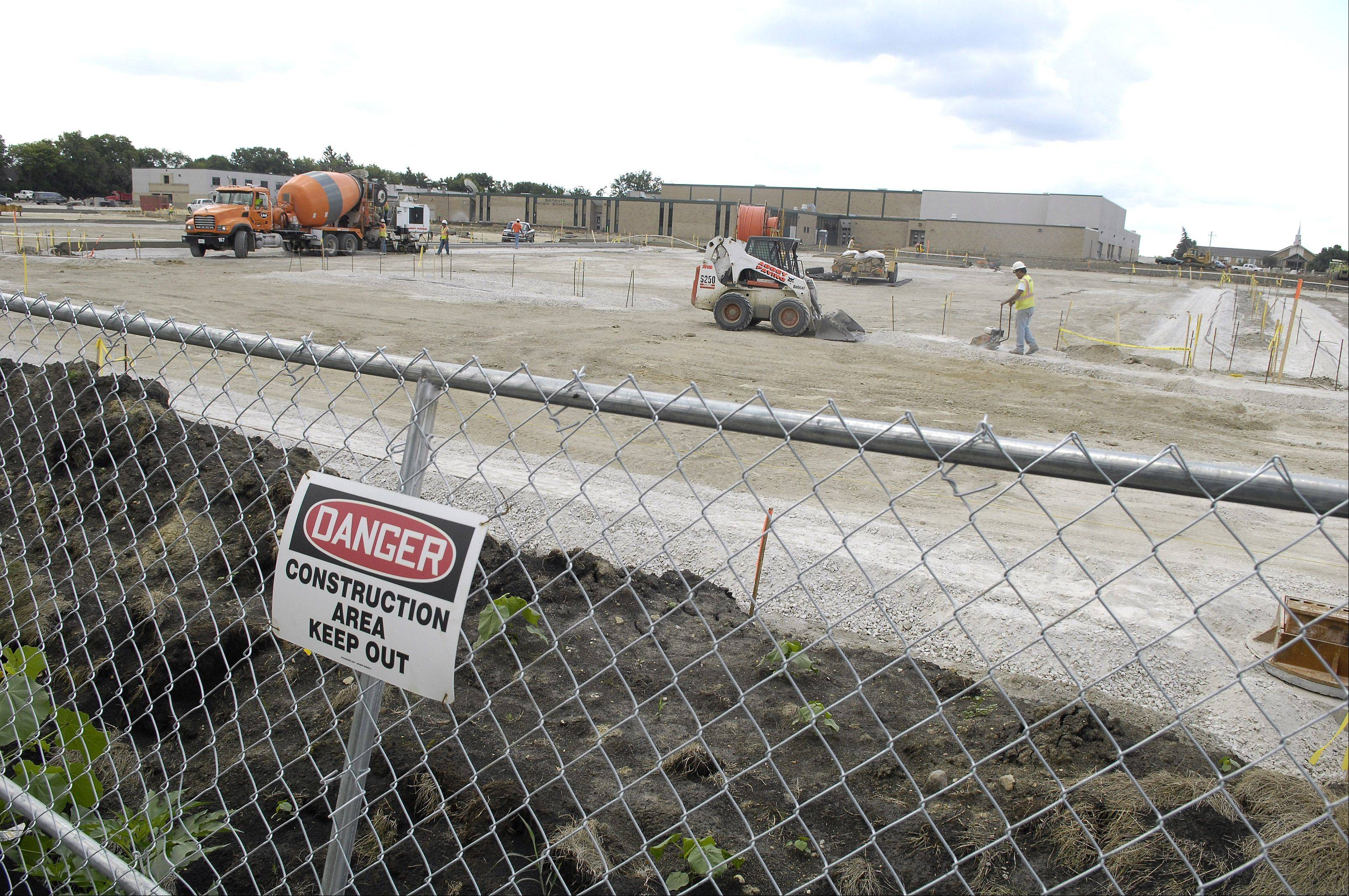 The entire rear lot of Batavia High School is under construction here in 2008. Impact fees for new businesses are used for road construction to help local infrastructure cope with increased usage. School districts generally welcome impact fees to help with structural costs.