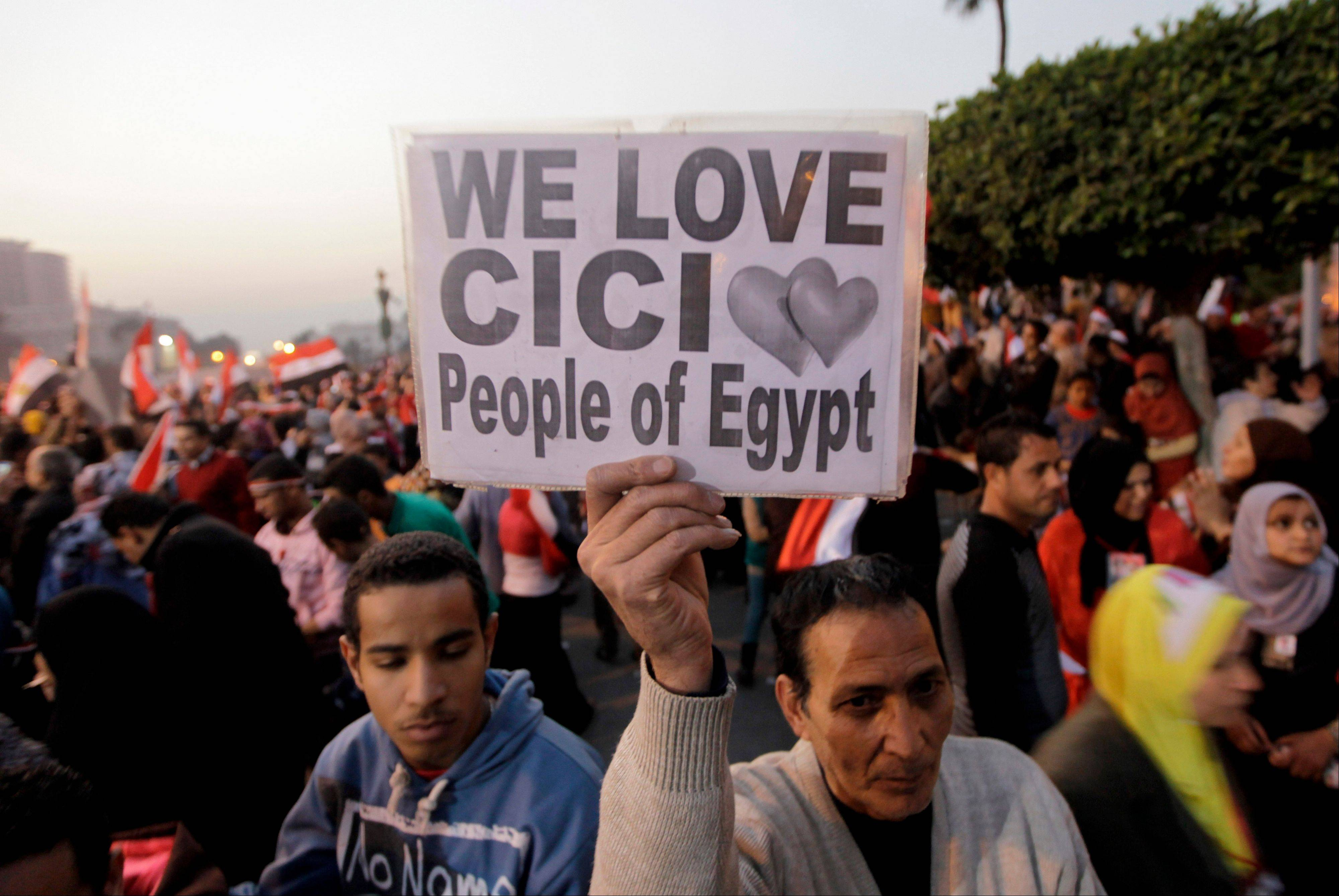 An Egyptian raises a placard Saturday supporting Egypt�s Defense Minister, Gen. Abdel-Fattah el-Sissi in Tahrir Square, the epicenter of the 2011 uprising, in Cairo, Egypt.