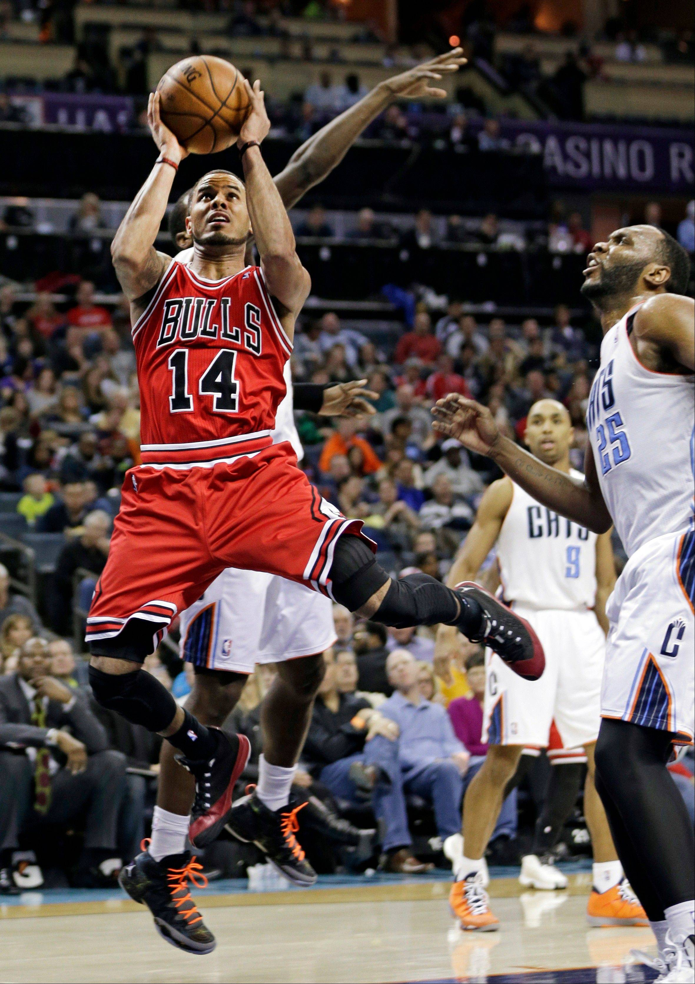 Bulls guard D.J. Augustin drives past the Bobcats� Al Jefferson during the second half Saturday night. Augustin finished with 28 points.