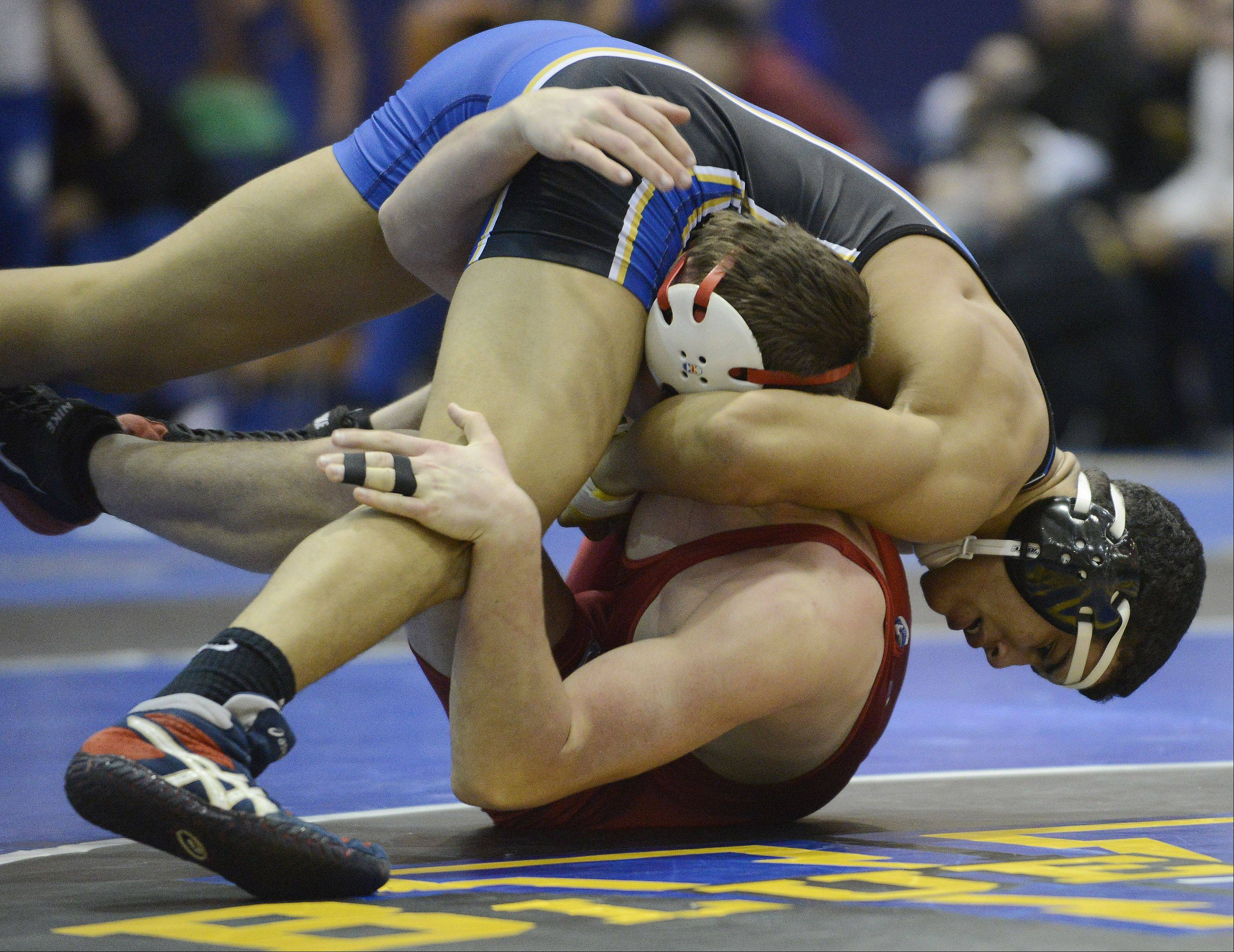 Warren�s Emery Parker, top, wrestles Marian Central�s Thomas Welch in a 160-pound match at Warren on Saturday.