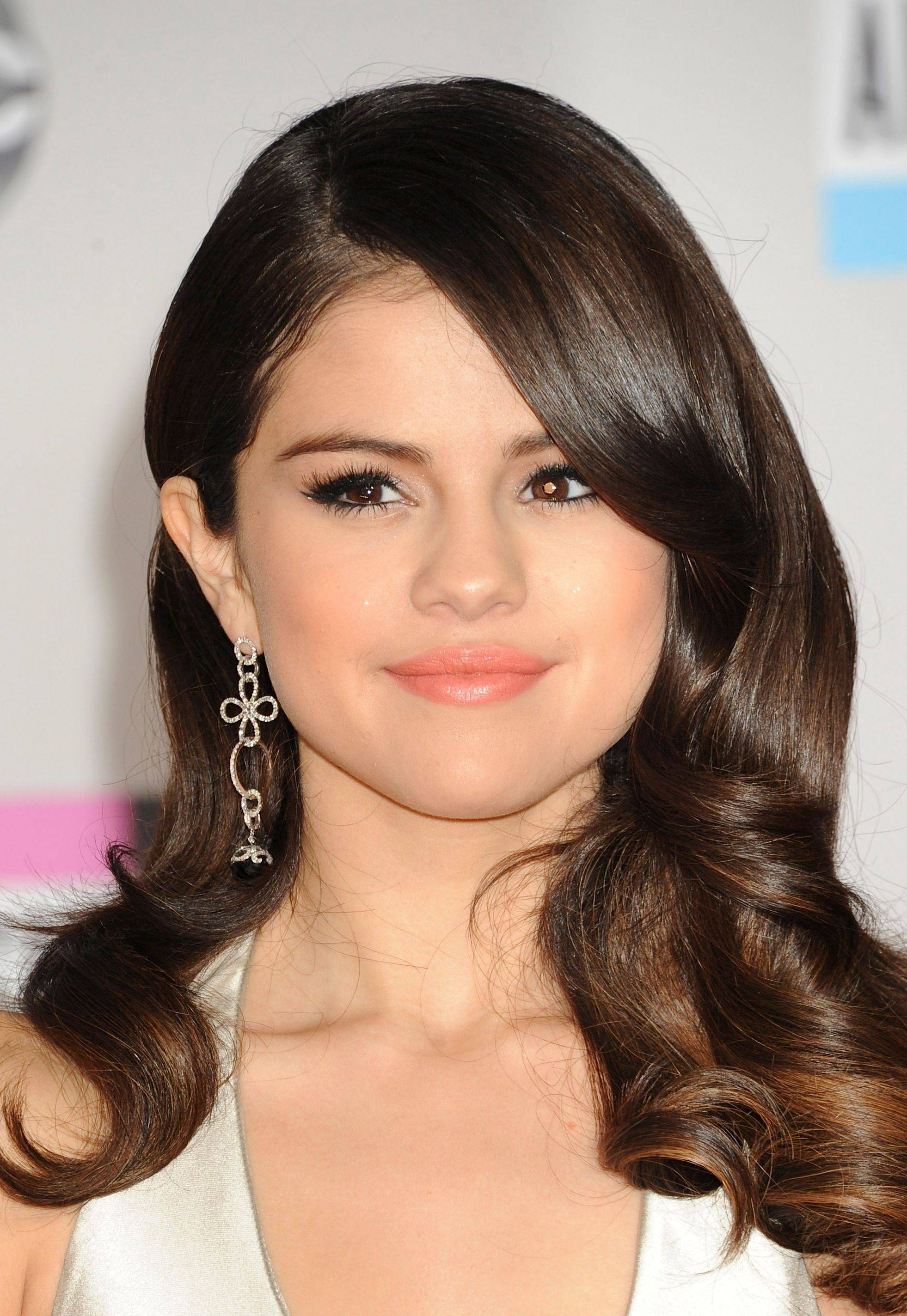 This Nov. 20, 2011 file photo shows Selena Gomez during arrivals to the 2011 American Music Awards in Los Angeles. Los Angeles police have arrested a 19-year-old man on suspicion of trespassing at the home of singer-actress Selena Gomez. Officials said a family member called 911 Saturday after seeing an intruder on the property in the Tarzana area.