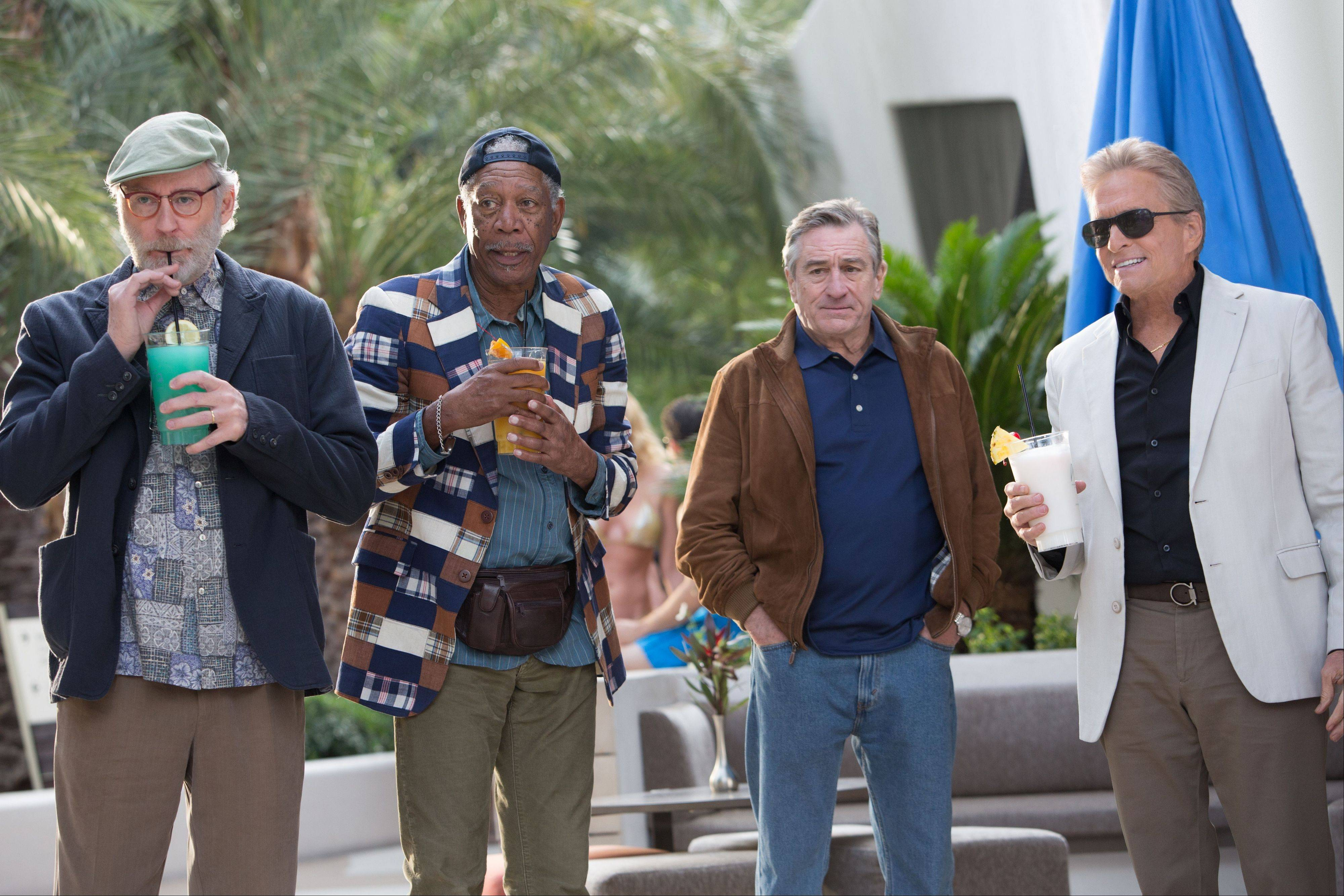 "Kevin Kline, left, Morgan Freeman, Robert De Niro and Michael Douglas star as old friends partying in Sin City in ""Last Vegas."""