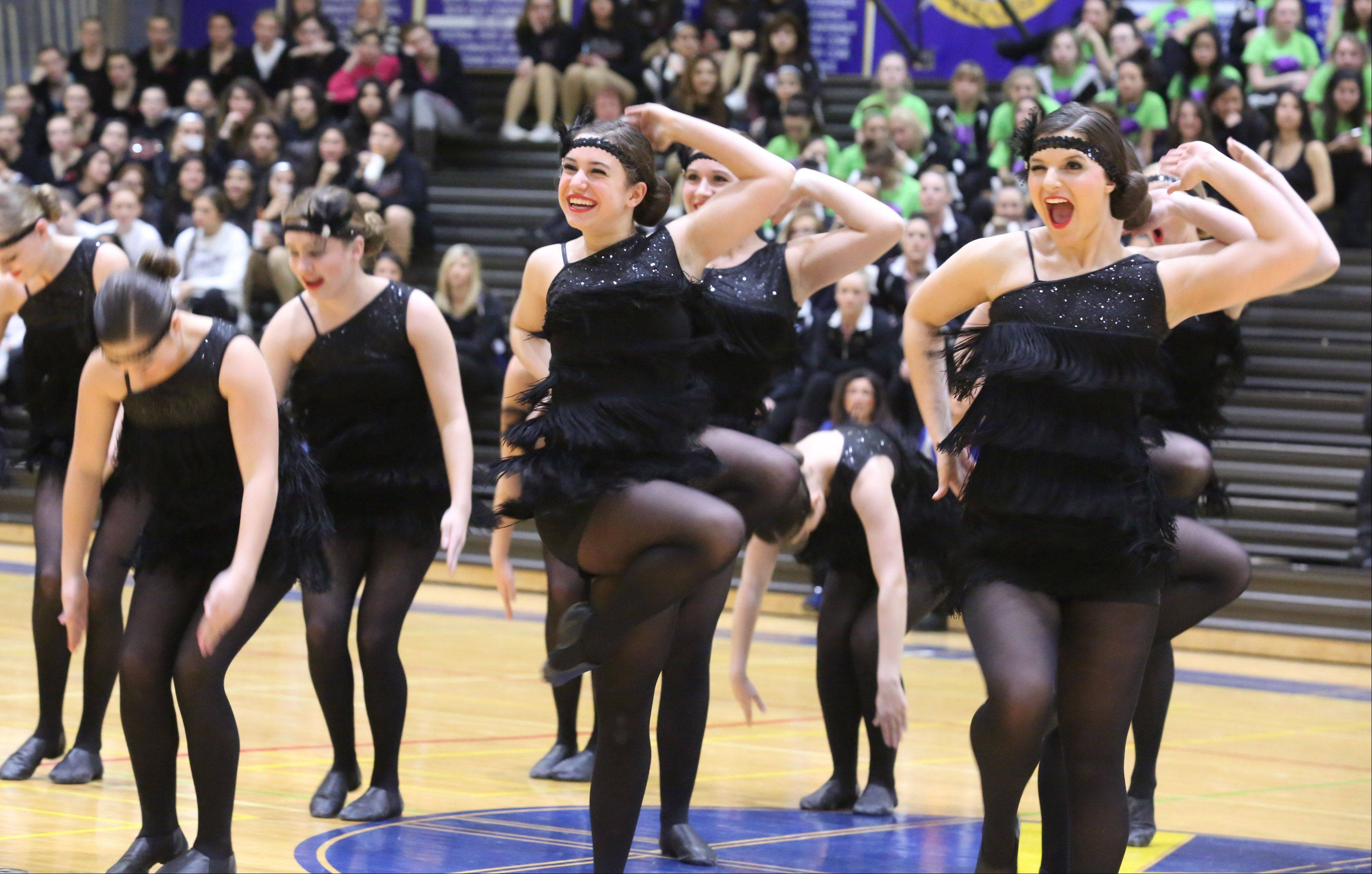 Glenbard West High School's dance team competes at the IHSA competitive dance sectional at Glenbrook South High School on Saturday in Glenview.
