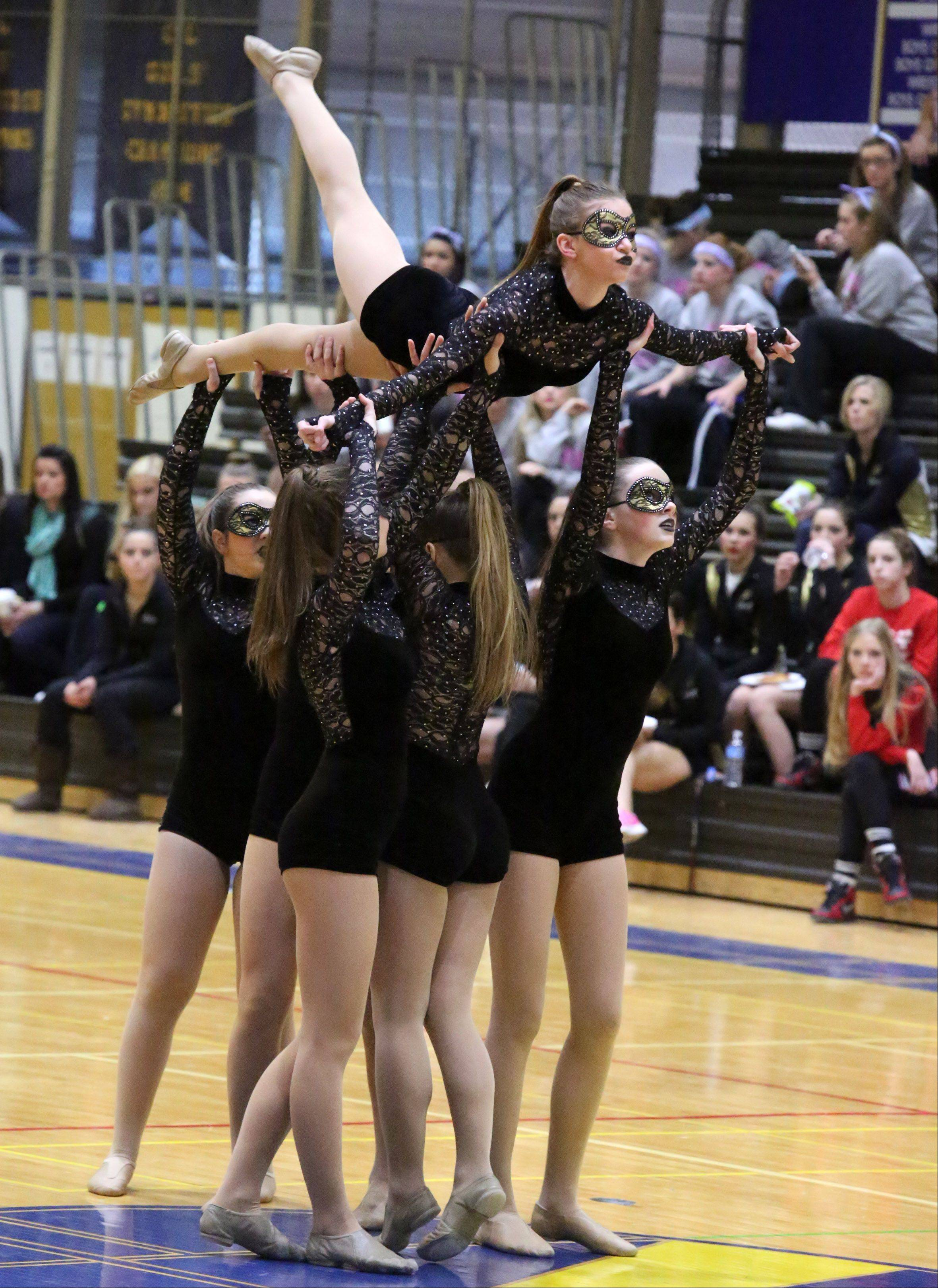 Carmel High School's dance team competes at the IHSA competitive dance sectional at Glenbrook South High School on Saturday in Glenview.