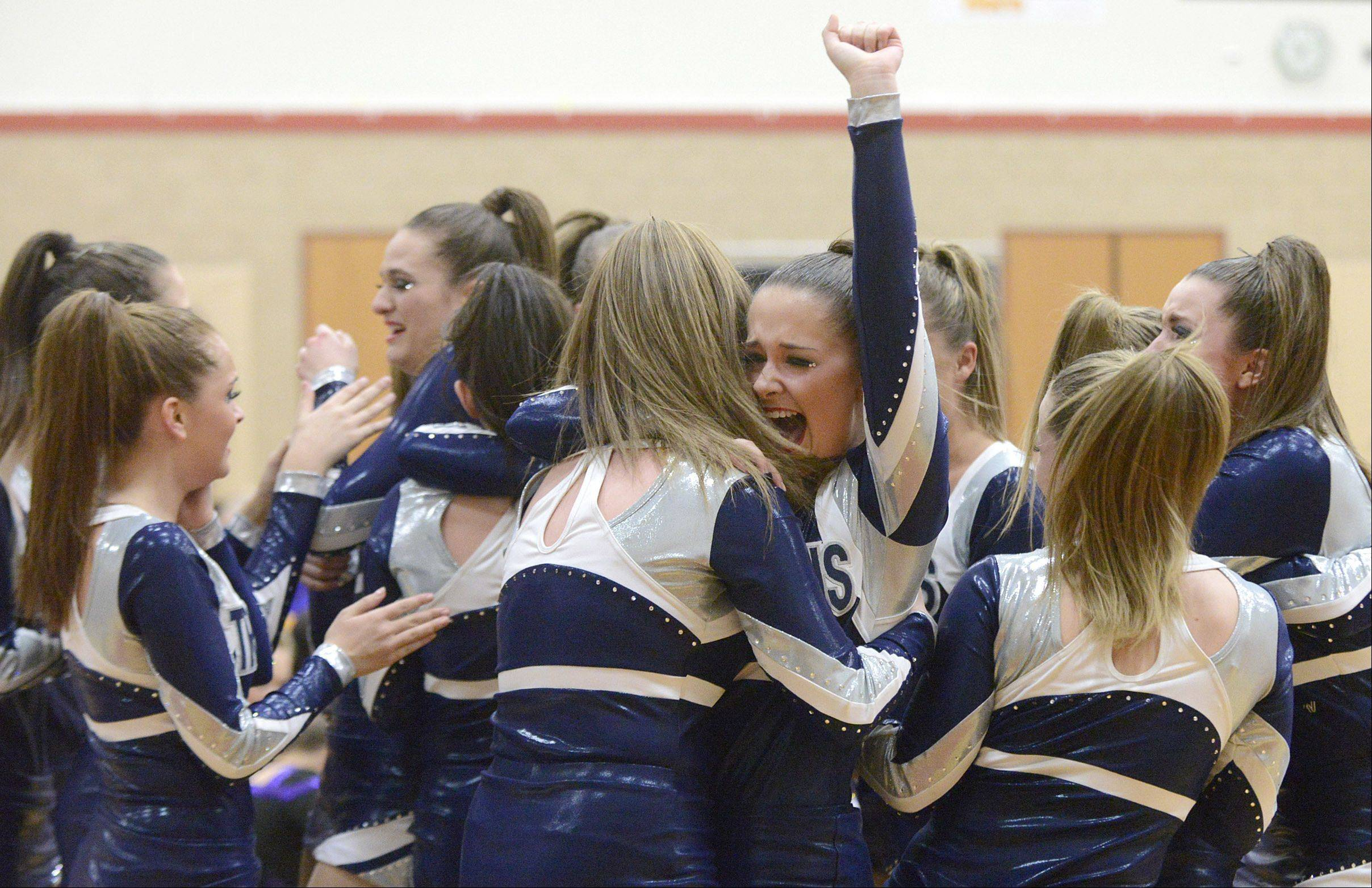 Laura Valentine, 16, throws her fist into the air celebrating Cary Grove High School's taking third place and making it to state during the IHSA 2A competitive dance sectionals at Huntley High School on Saturday.