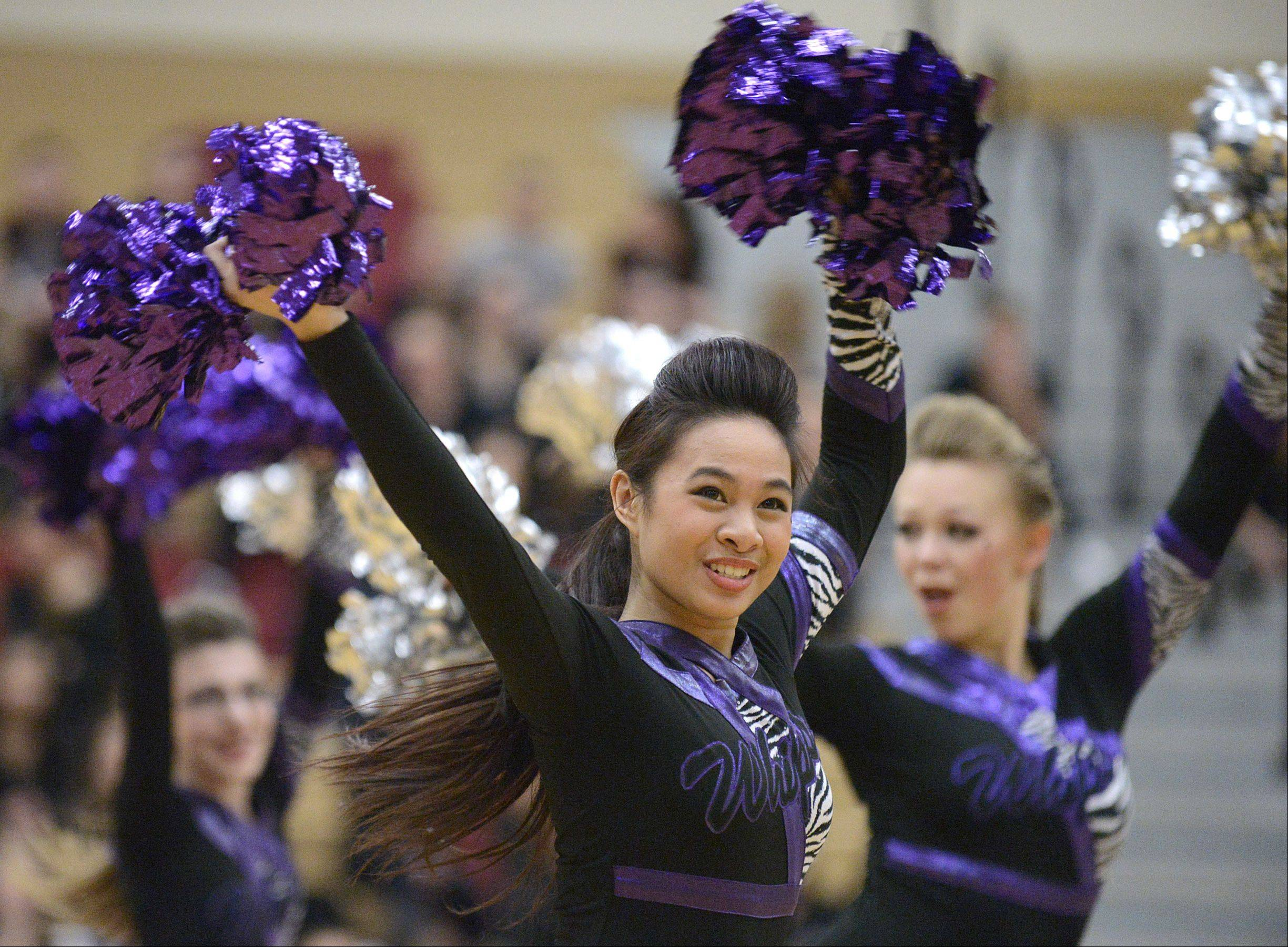 Mara De Guzman, 18, performs with the Hampshire High School team in the IHSA 2A competitive dance sectionals at Huntley High School on Saturday.