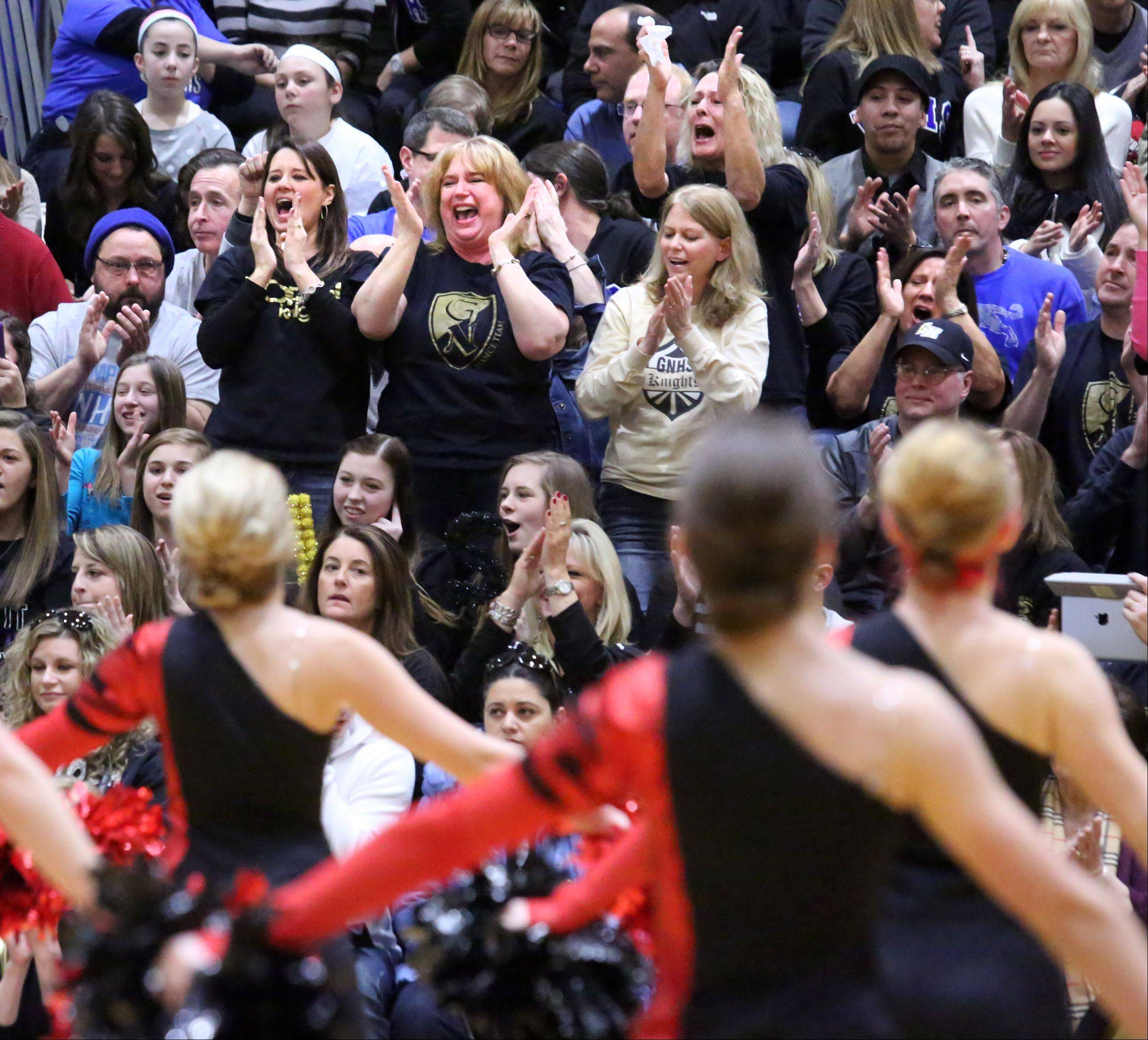 Grayslake North High School's dance team parents and fans cheer after the team competes at the IHSA competitive dance sectional at Glenbrook South High School on Saturday in Glenview.