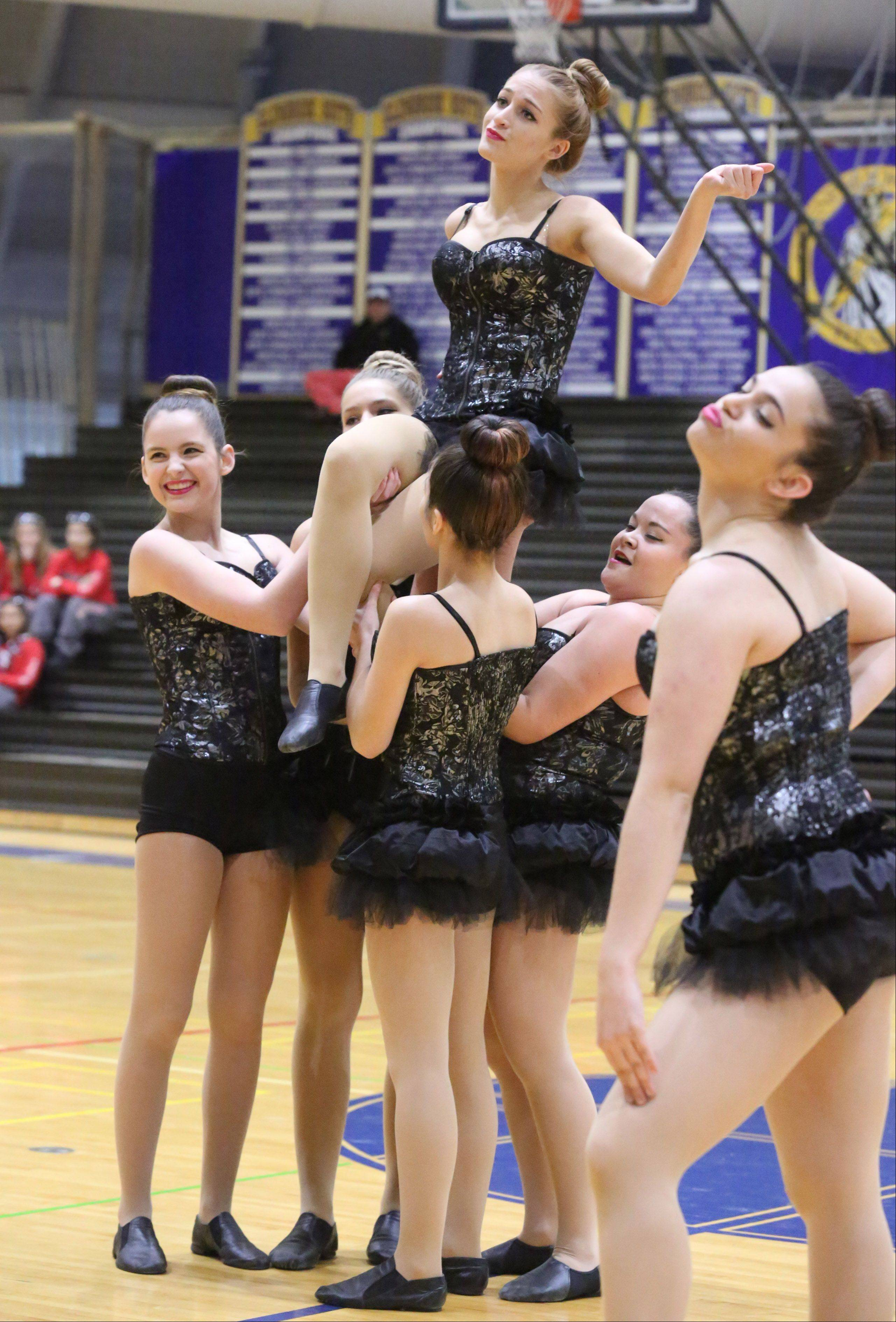Hoffman Estates High School's dance team competes at the IHSA competitive dance sectional at Glenbrook South High School on Saturday in Glenview.