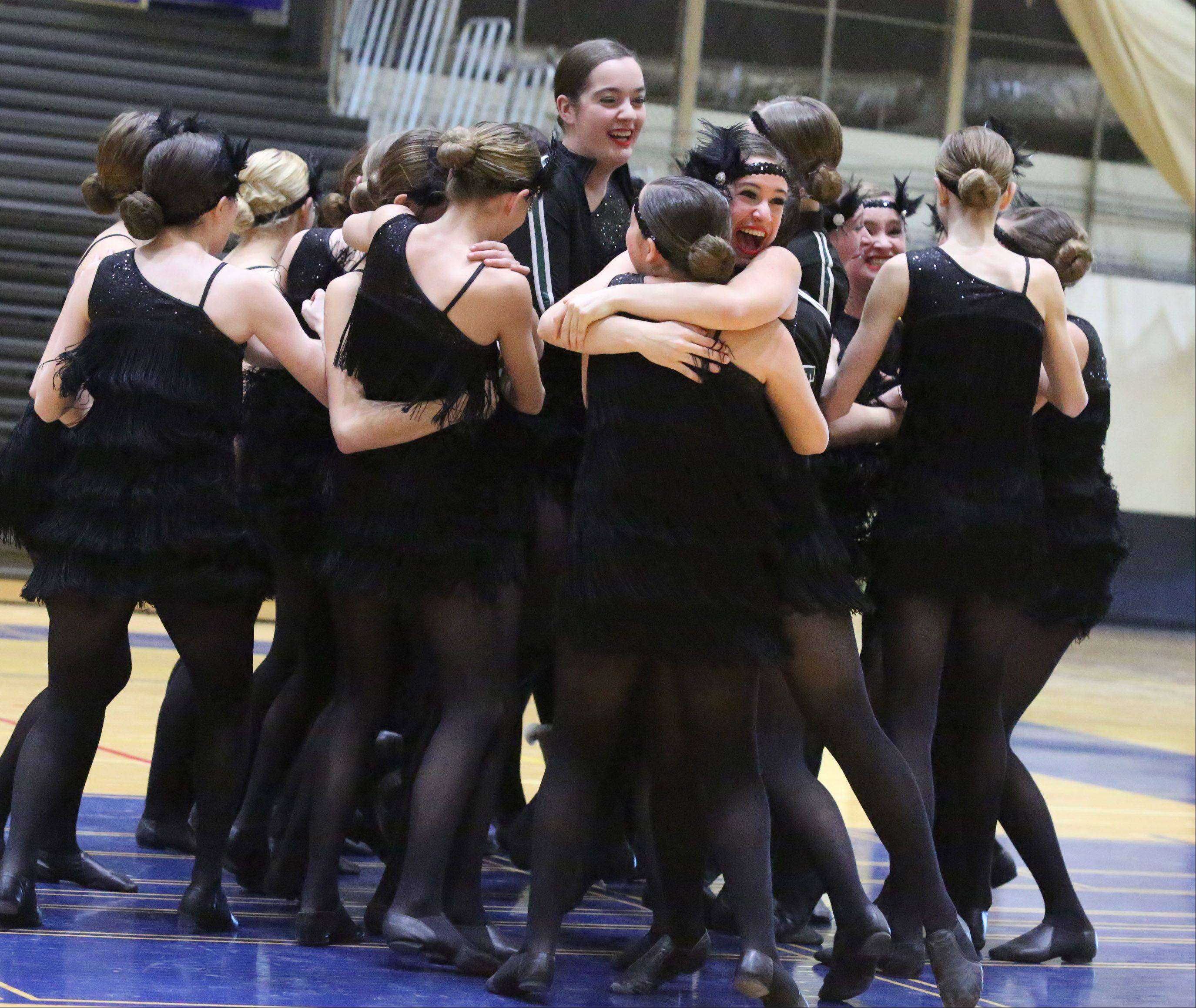 Glenbard West High School's dance team celebrates placing at the IHSA competitive dance sectional at Glenbrook South High School on Saturday in Glenview.