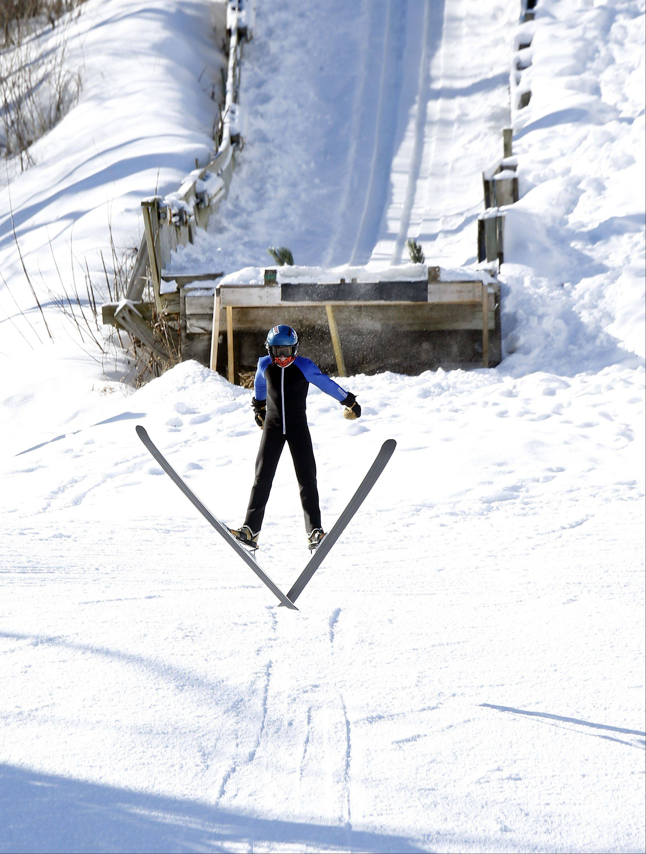 Woody Waugh, 12, of Cloquet, Minn., launches himself from the 40-meter ramp during warm-ups at the 109th Norge Ski Jump Tournament Saturday in Fox River Grove. Typically, 50 to 60 competitors register for the event. However, this year saw a surge in registrations, likely due to people excited about the upcoming Winter Olympics in Sochi, Russia.