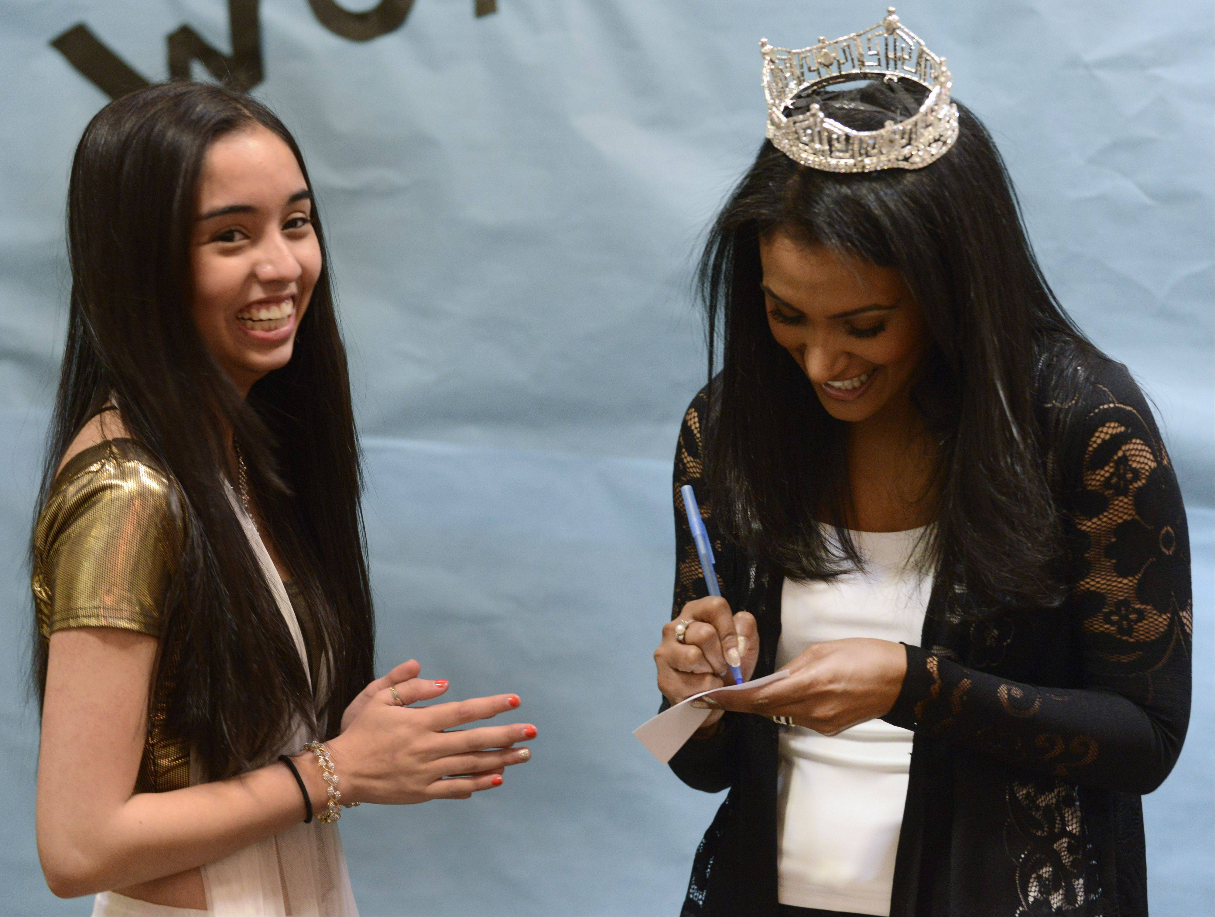 Stevenson High School junior Sailee Karmarkar gets an autograph from Nina Davuluri, Miss America 2014, during her visit Saturday to the Stevenson High School World's Fair event in Lincolnshire.