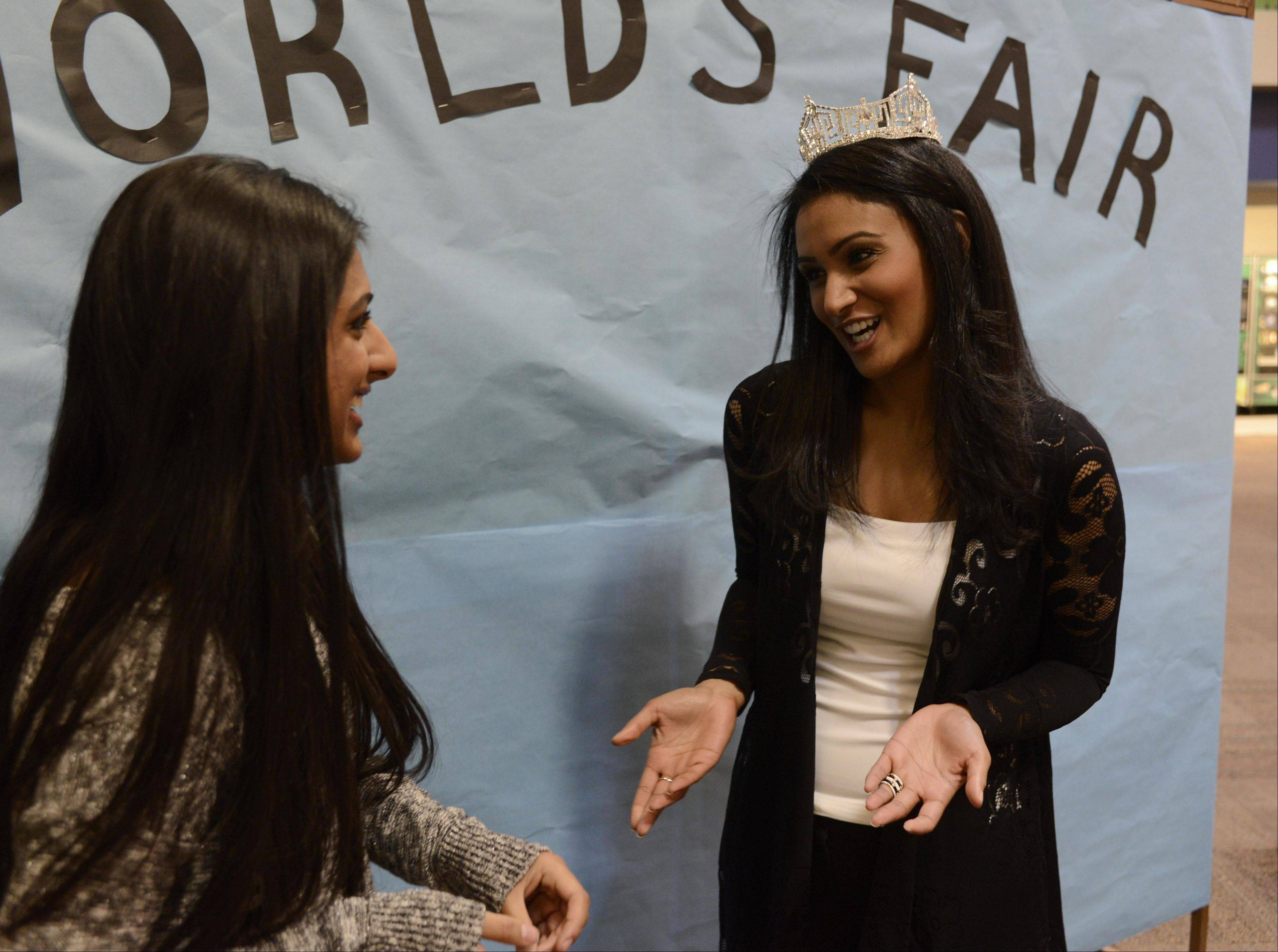 Fathma Rahman, left, a Stevenson High School junior, invited Nina Davuluri, Miss America 2014, to visit Saturday the Stevenson High School World's Fair event in Lincolnshire.