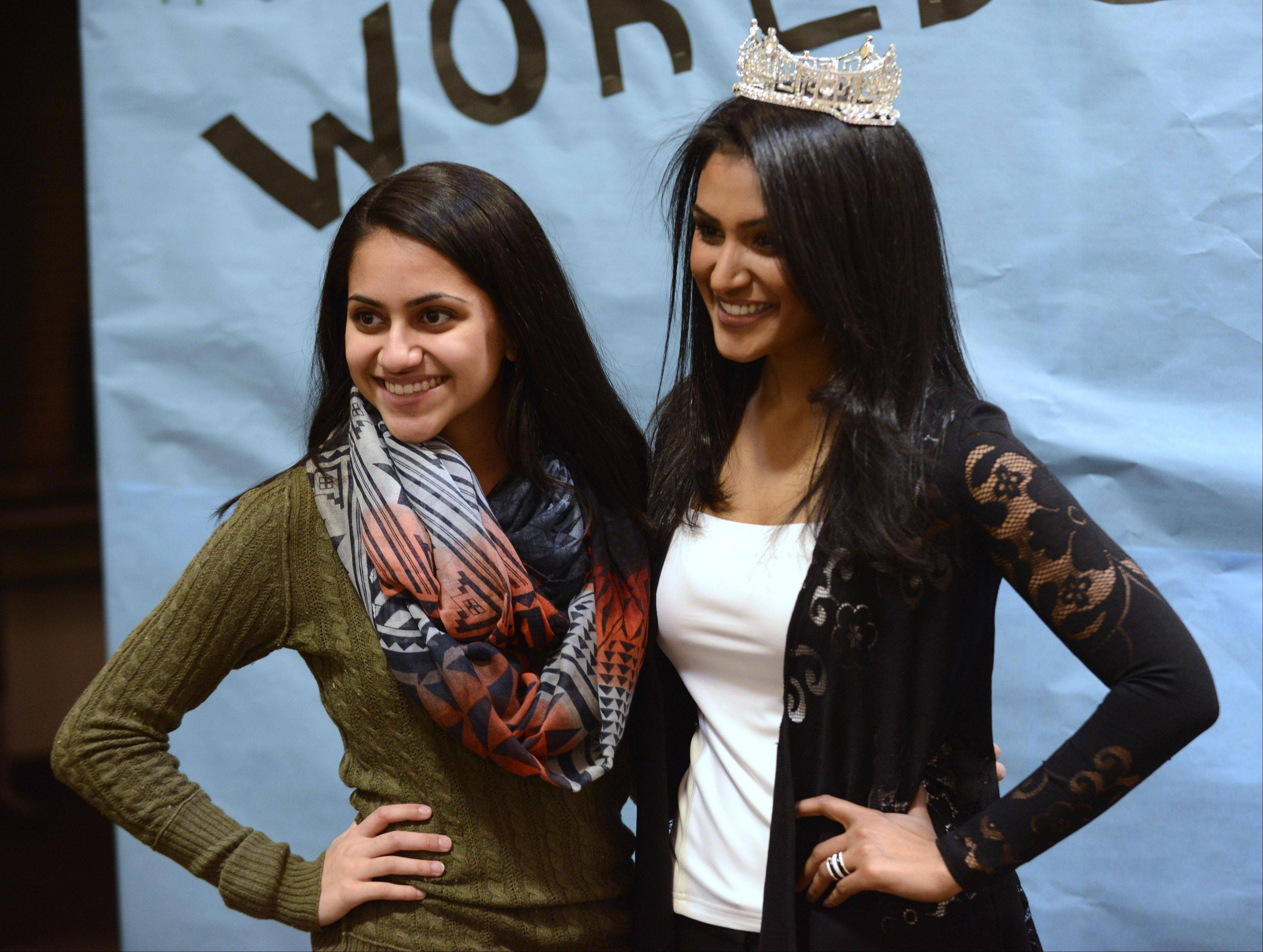 Stevenson High School sophomore Anjali Patel poses for a photo with Nina Davuluri, Miss America 2014, during her visit Saturday at the Stevenson High School World's Fair event in Lincolnshire.