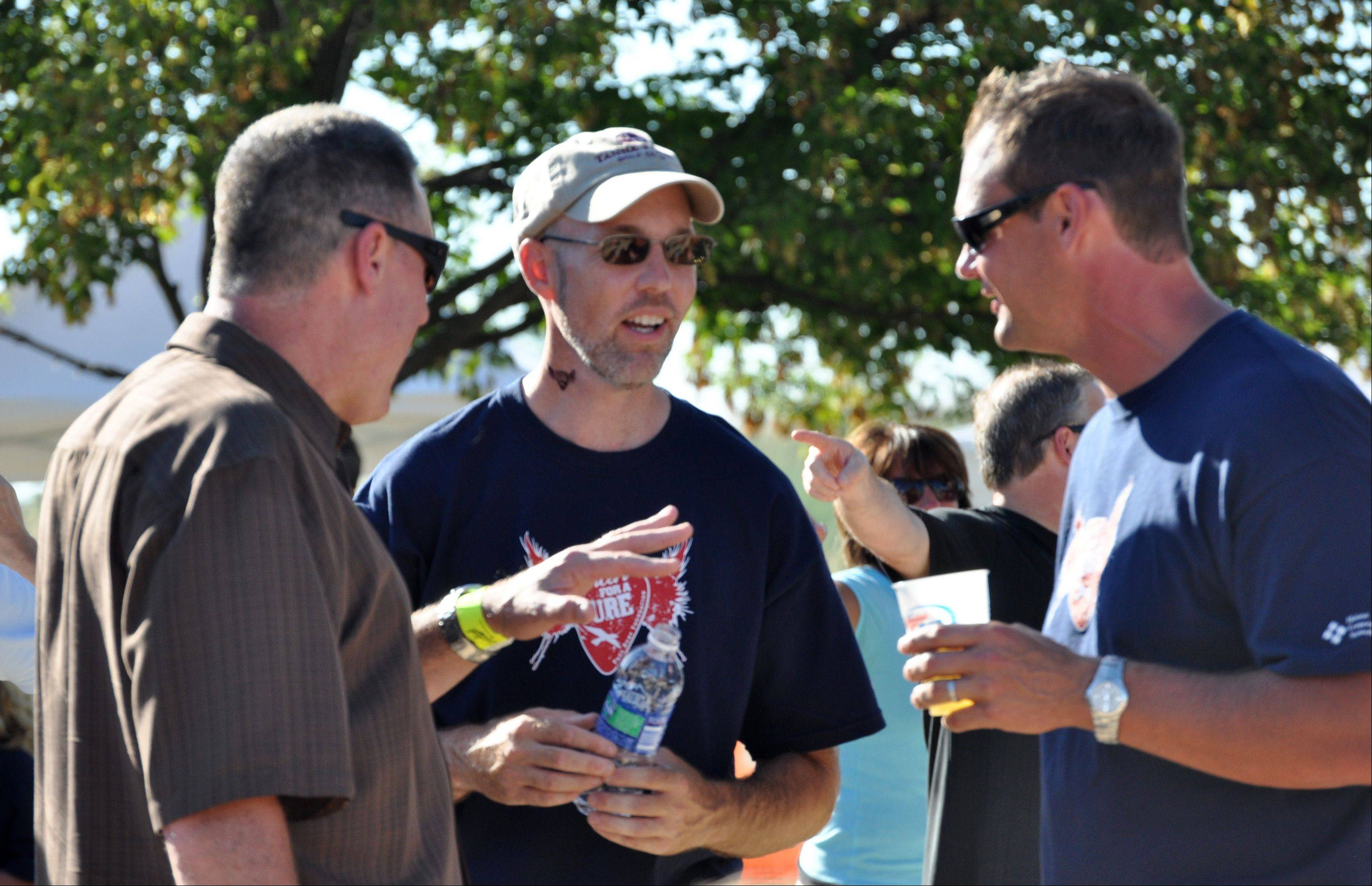 DAILY HERALD PHOTO Paul Ruby, center, visits with guests at the 2008 fundraiser to benefit Parkinson's disease research.