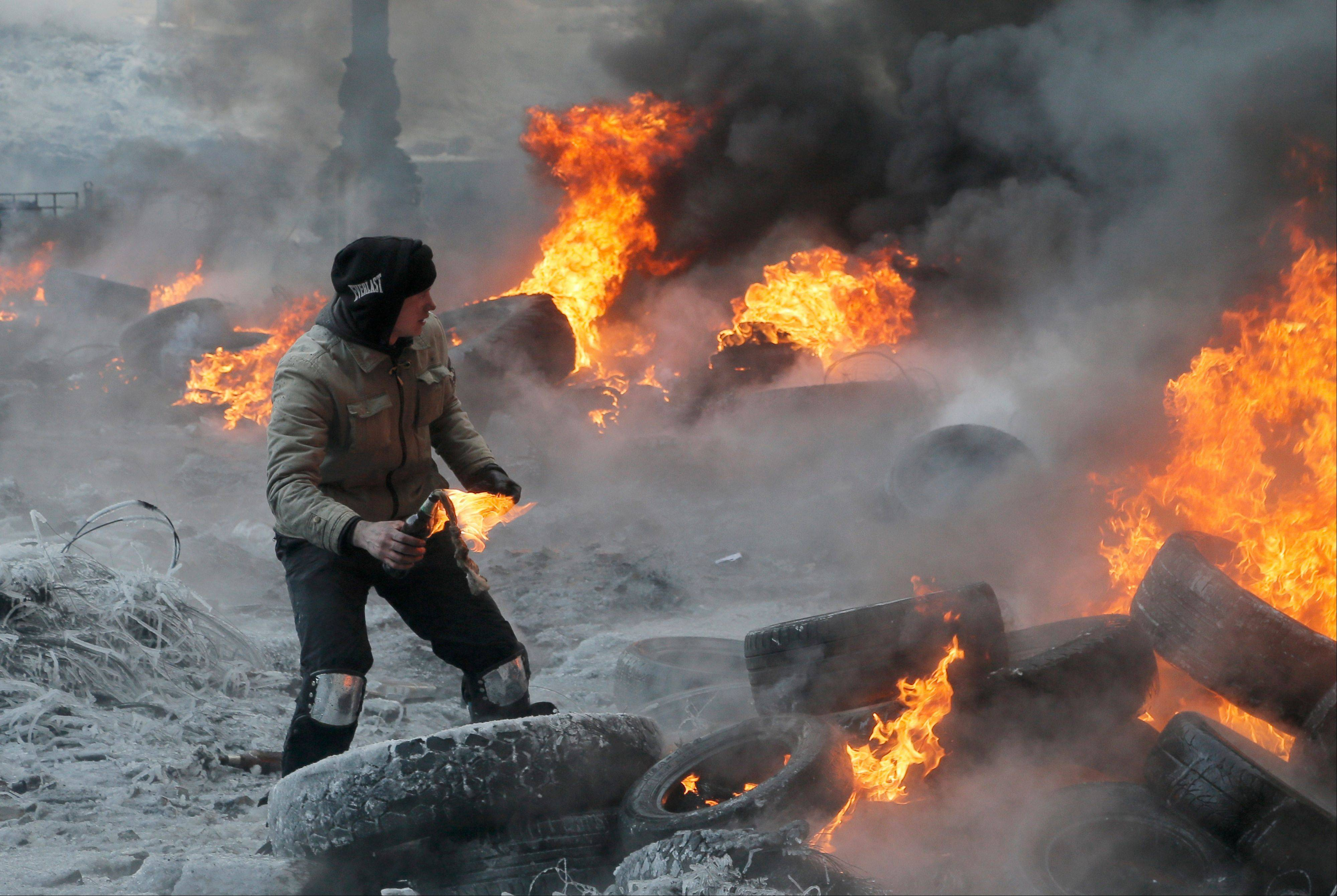 Associated PressA protester throws a Molotov cocktail towards riot police.