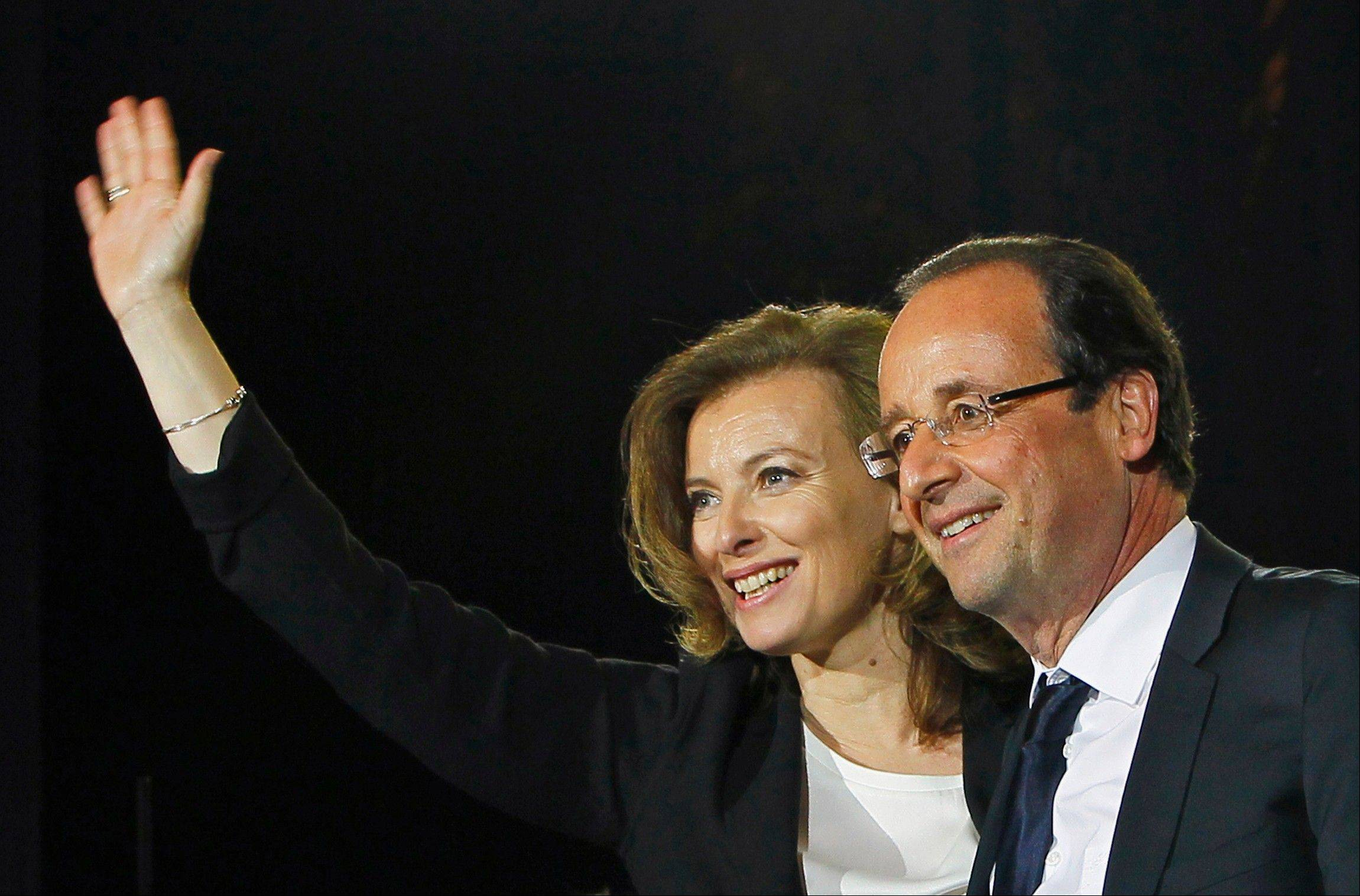 French president-elect Francois Hollande and his companion Valerie Trierweiler celebrating his election victory in Bastille Square in Paris, France.