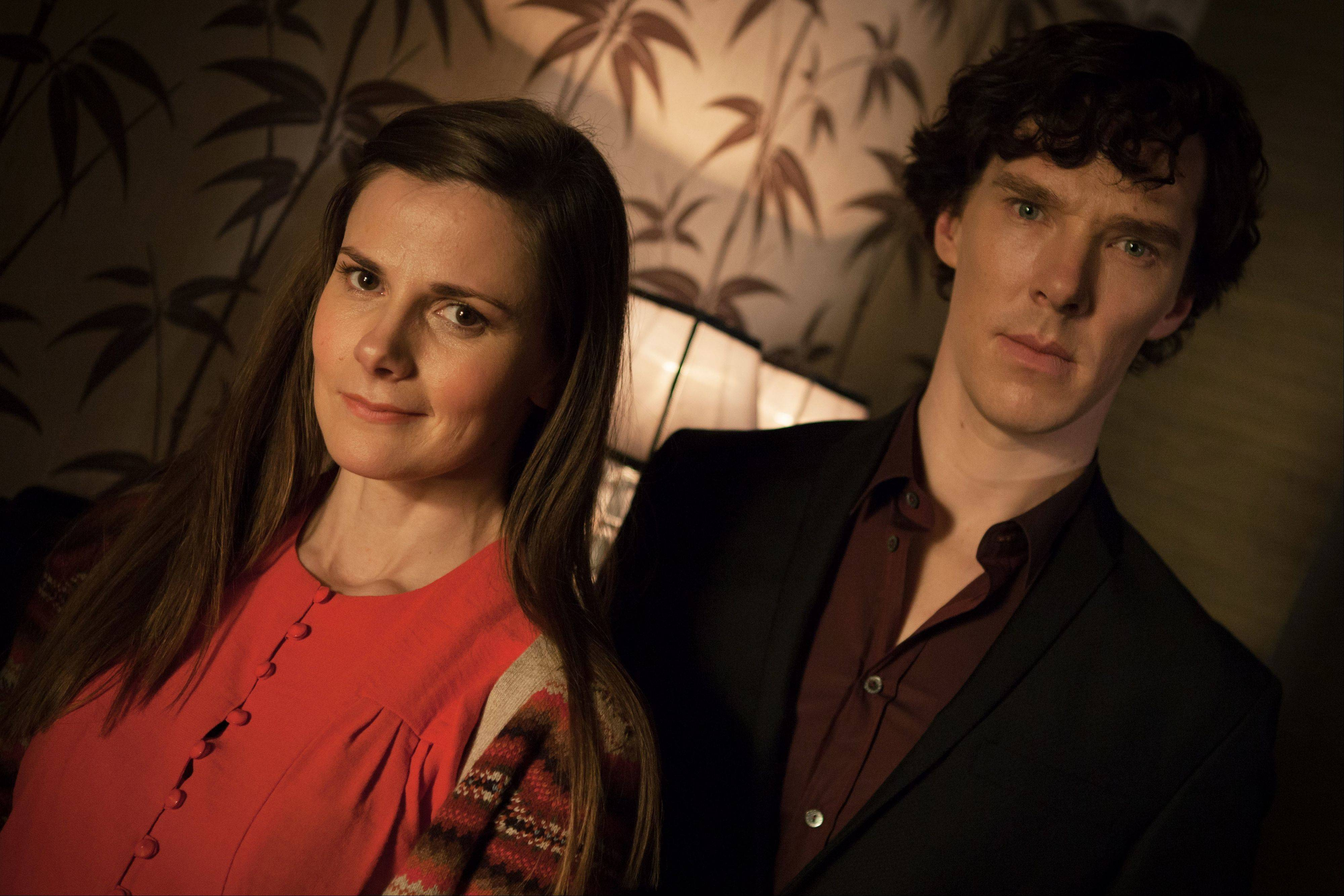 "Louise Brealey, left, as Molly Hooper and Benedict Cumberbatch as Sherlock Holmes, in a scene from Season 3, ""The Empty Hearse"" episode of Masterpiece's ""Sherlock,"" which aired on Jan. 19, 2014, on PBS."