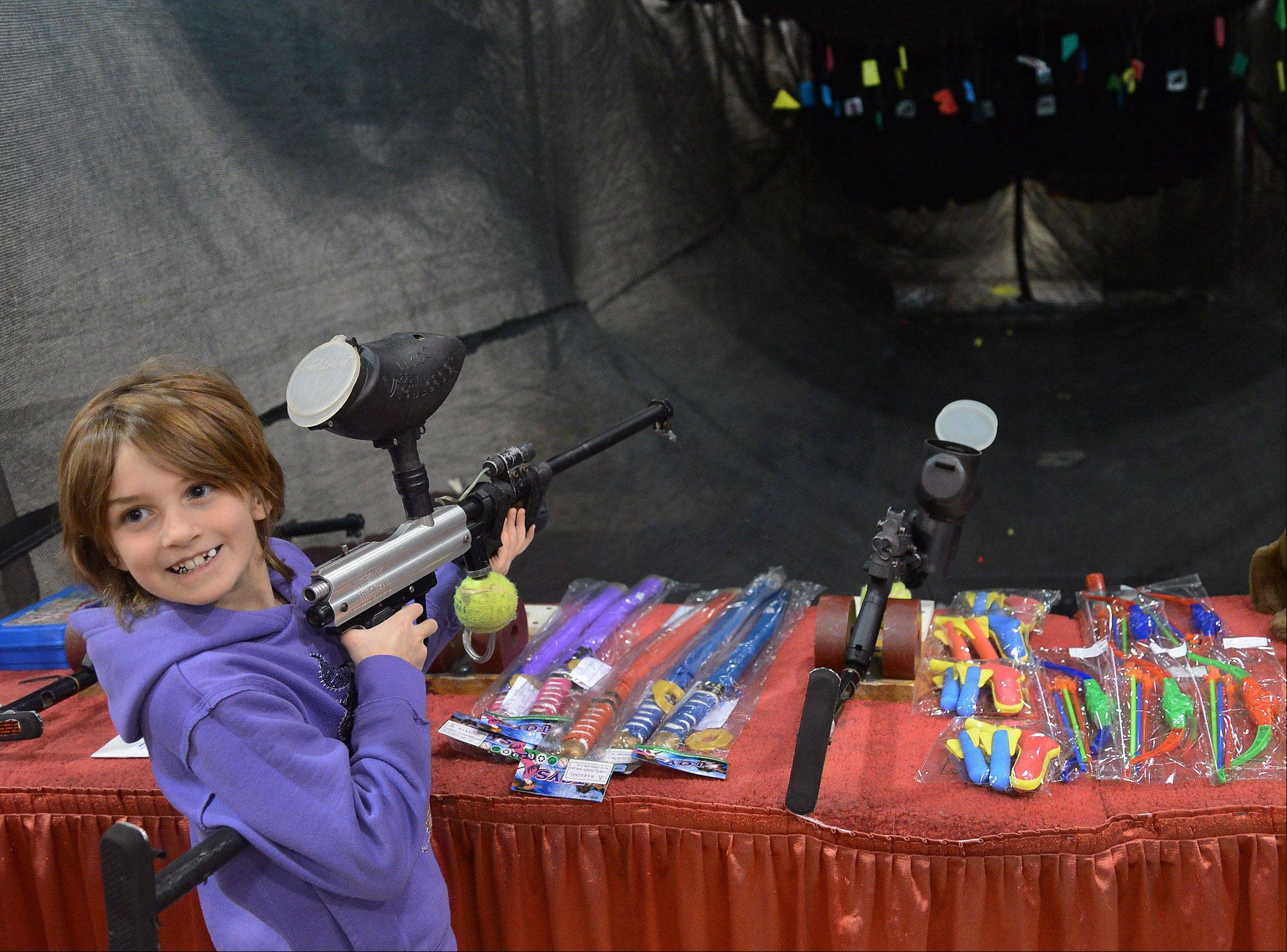 Adaire Matthias of Crown Point, Ind., tries her luck at some target practice Friday at the 28th Annual Chicago Outdoor Sports Show at the Donald E. Stephens Convention Center in Rosemont.