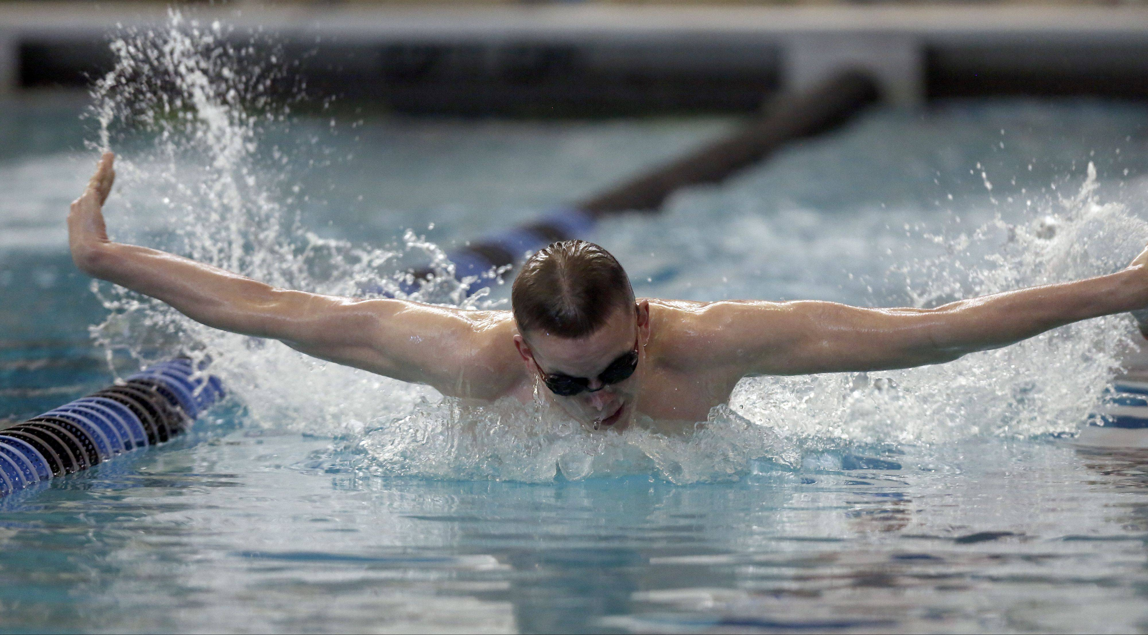 St. Charles North's Ross Davis swims the 200 yard individual medley during St. Charles North's invite Saturday in St. Charles.