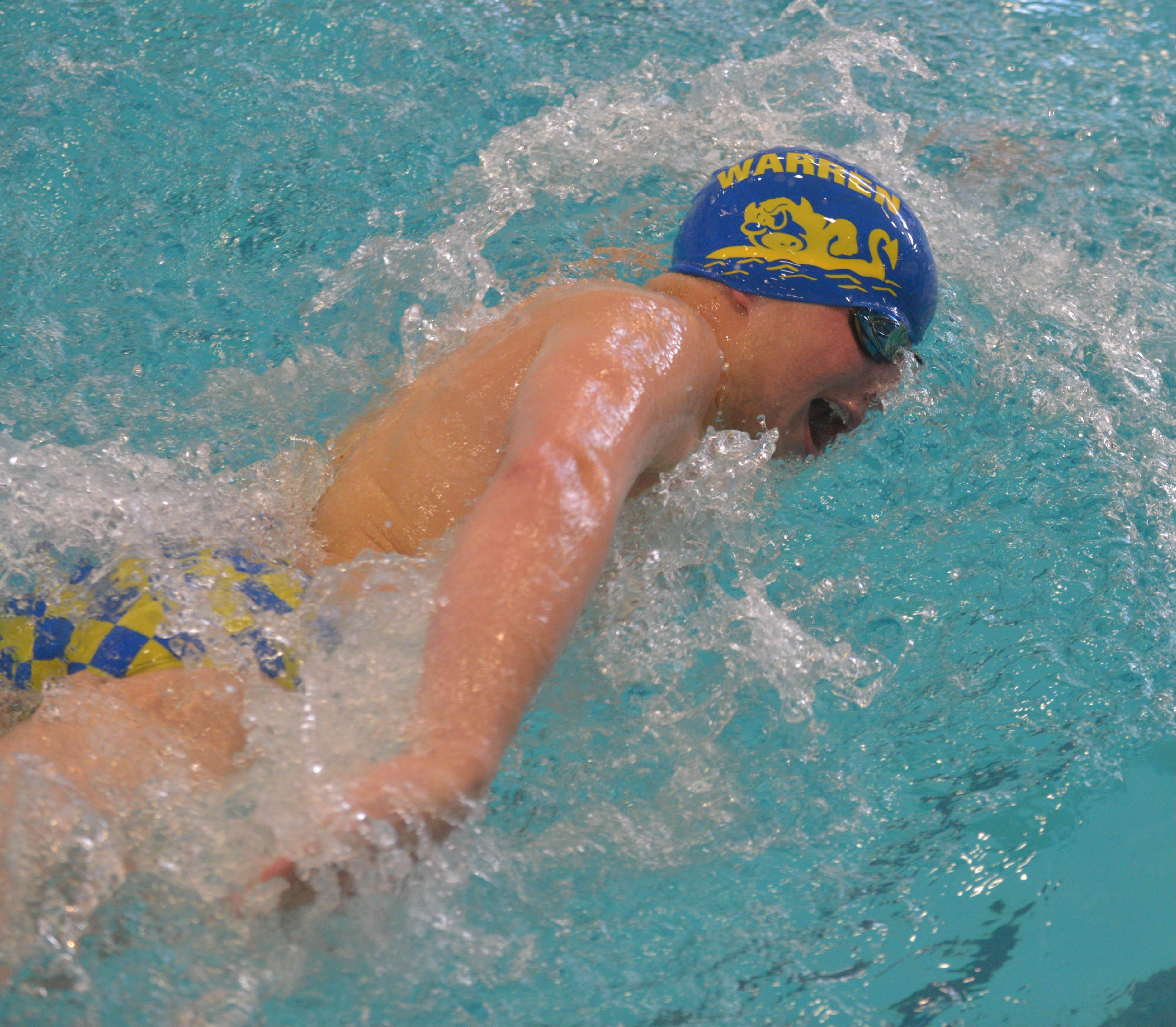 Austin Salisbury of Warren takes a leg of the 200-yard free relay on Saturday at Hinsdale Central.
