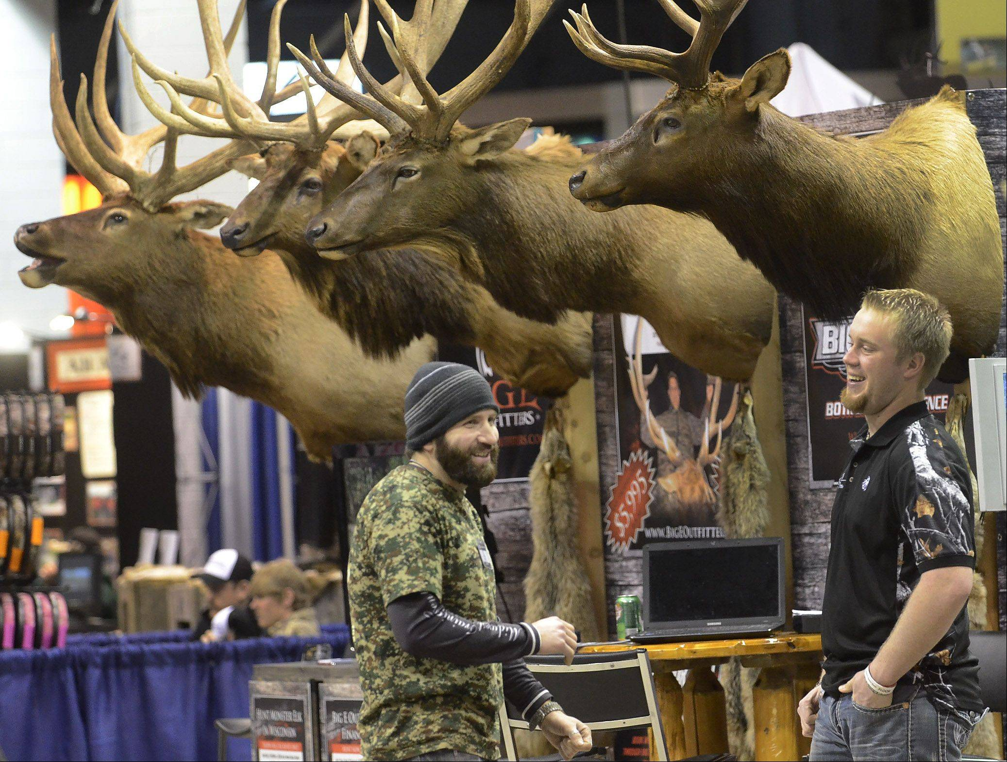 Kevin Finizio, of Addison, left, talks with Brandon Eger, of Big E Outfitters, at the 28th Annual Chicago Outdoor Sports Show at the Donald E. Stephens Convention Center in Rosemont.