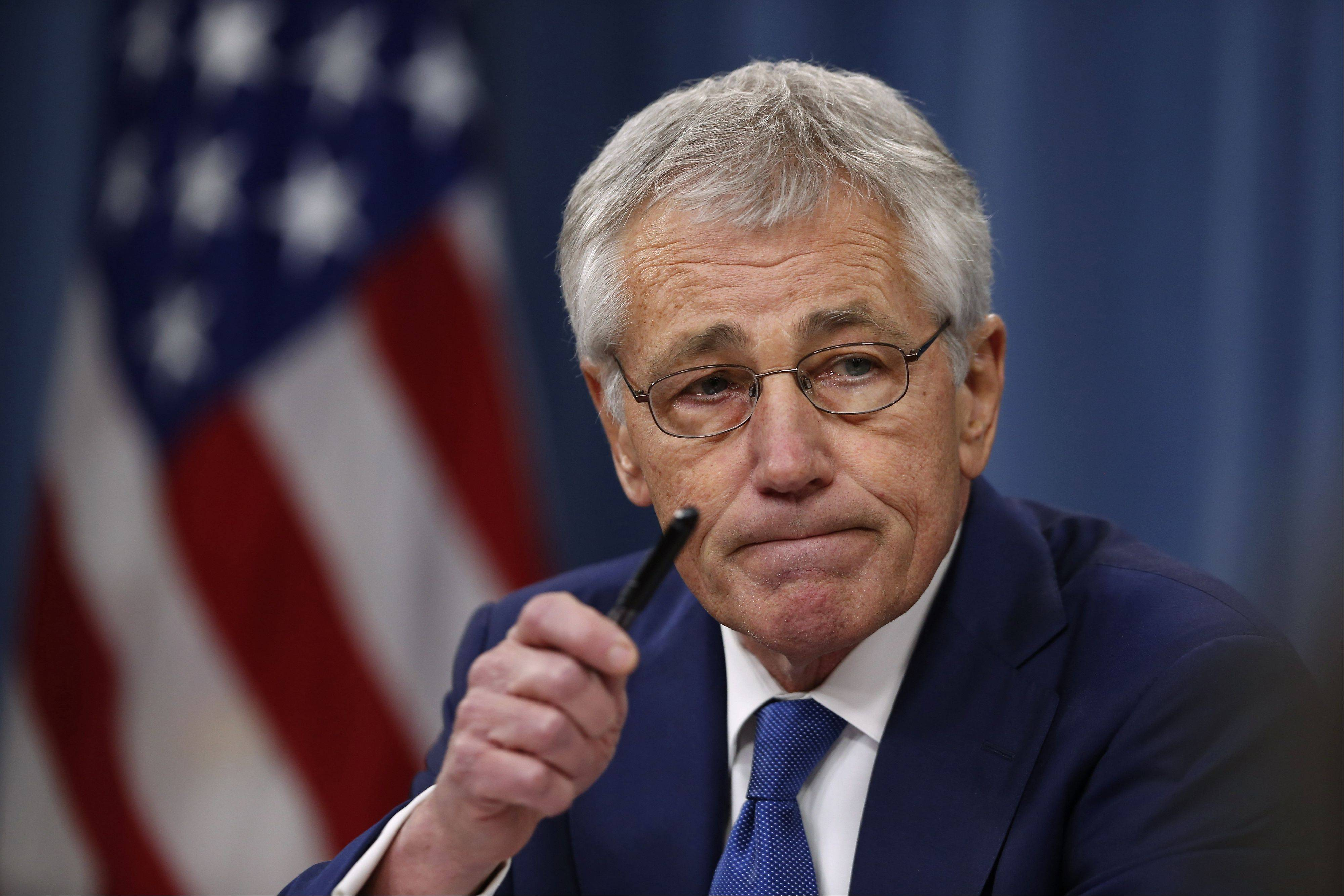Defense Secretary Chuck Hagel takes questions as he briefs reporters at the Pentagon in Washington.
