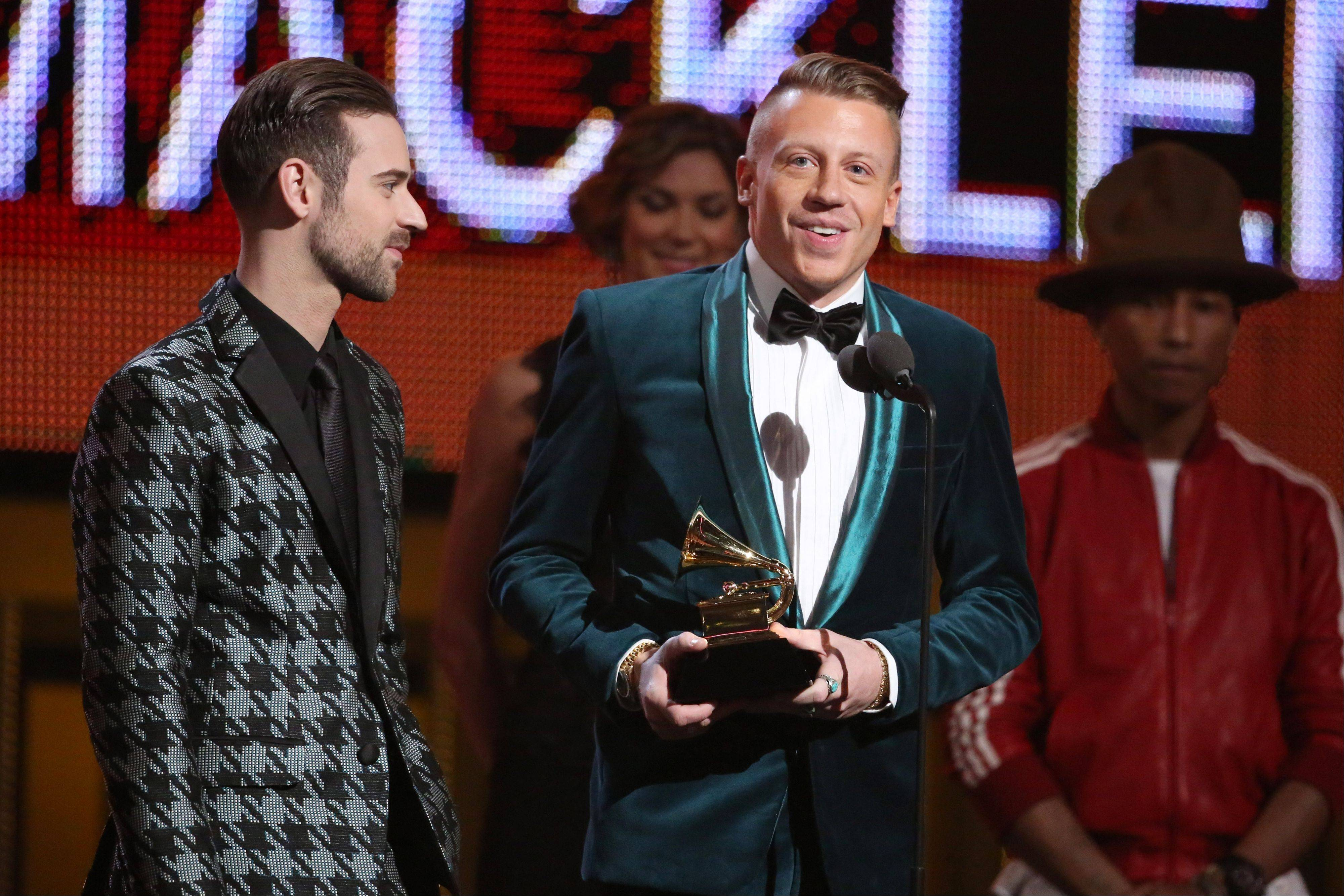 Ryan Lewis, left, and Macklemore accept the award for best new artist at the 56th annual Grammy Awards at Staples Center on Sunday in Los Angeles.