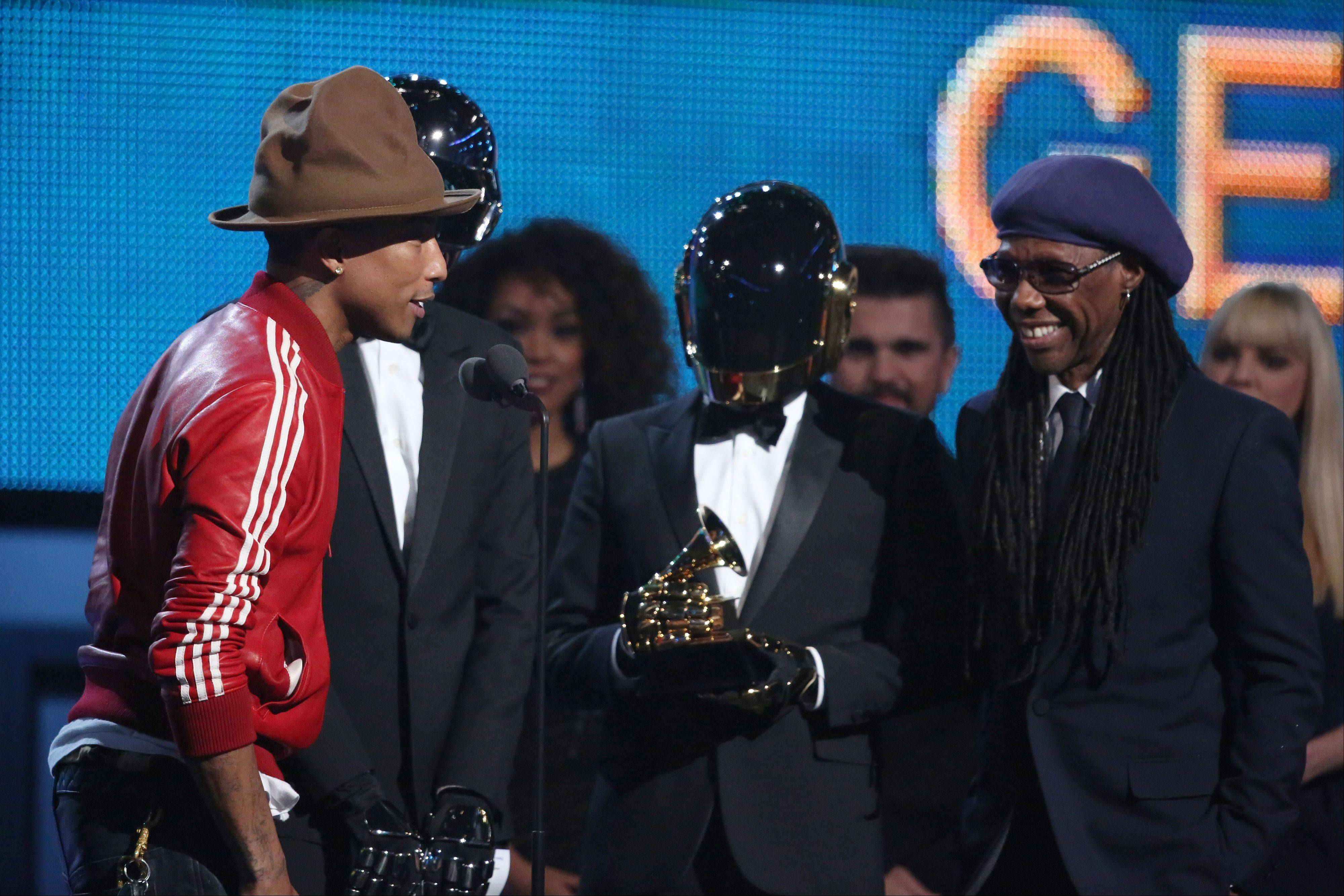 Pharrell Williams, from left, Daft Punk and Nile Rodgers accept the award for best pop duo/group performance at the 56th annual Grammy Awards at Staples Center on Sunday in Los Angeles.
