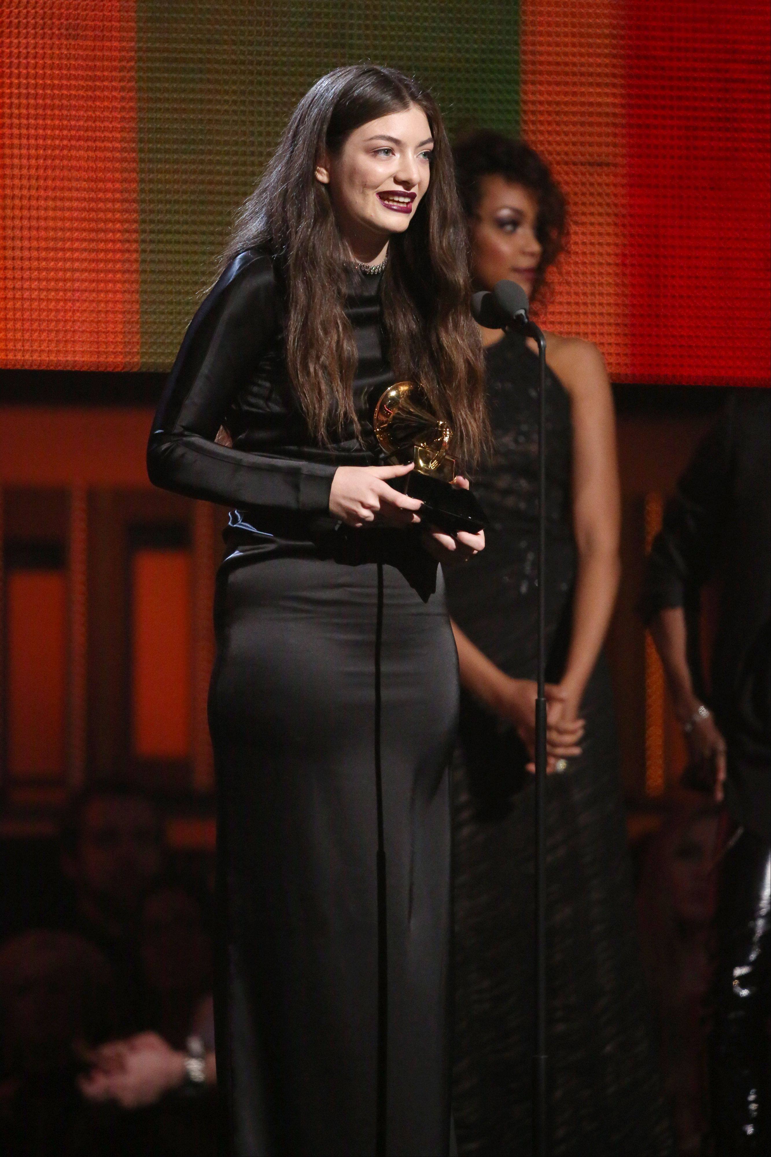 "Lorde accepts the award for best pop solo performance for ""Royals"" at the 56th annual Grammy Awards at Staples Center on Sunday in Los Angeles."