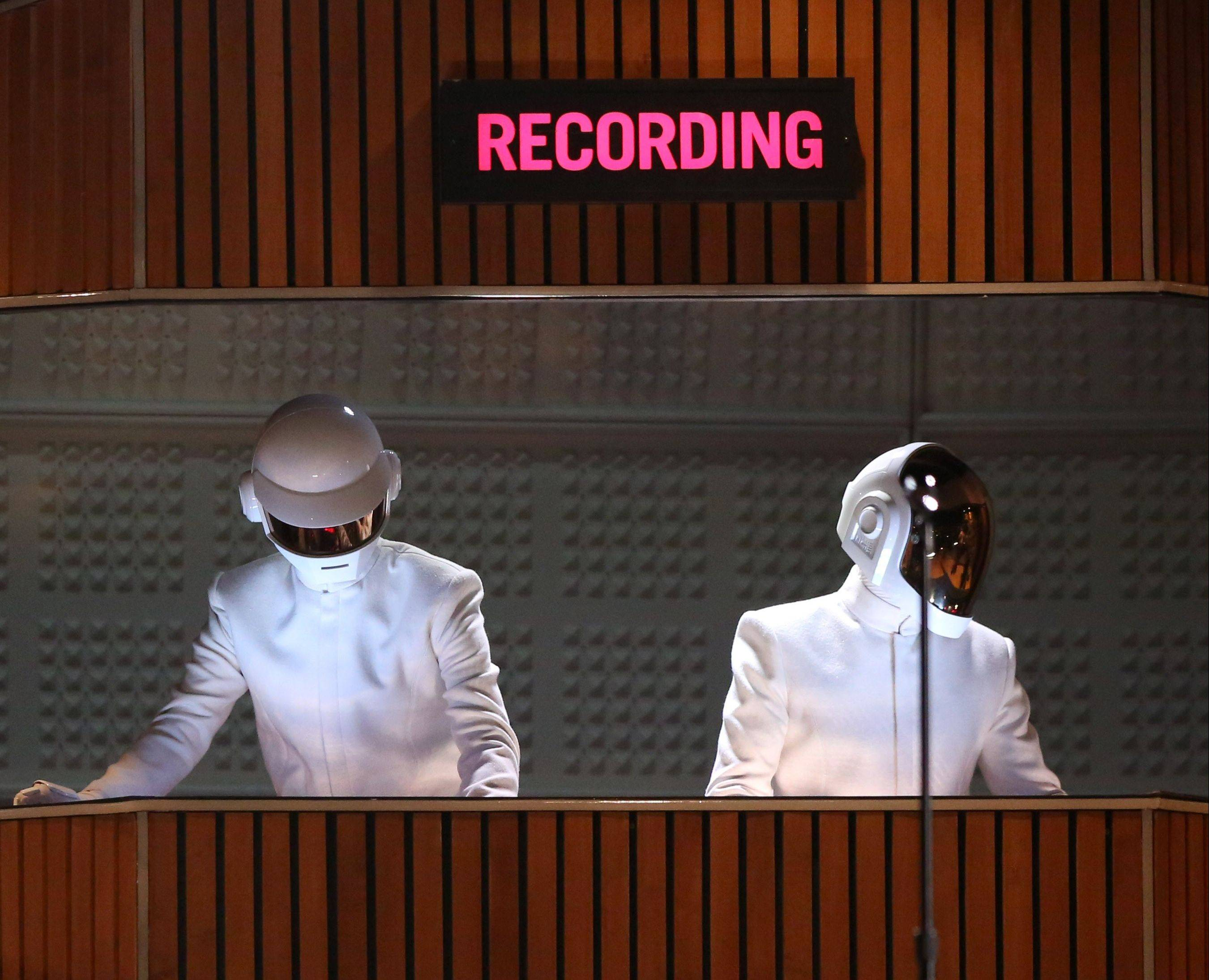 Thomas Bangalter, left, and Guy-Manuel de Homem-Christo of Daft Punk perform at the 56th annual Grammy Awards at Staples Center on Sunday in Los Angeles. The duo would go on to win Grammys for album of the year and record of the year.