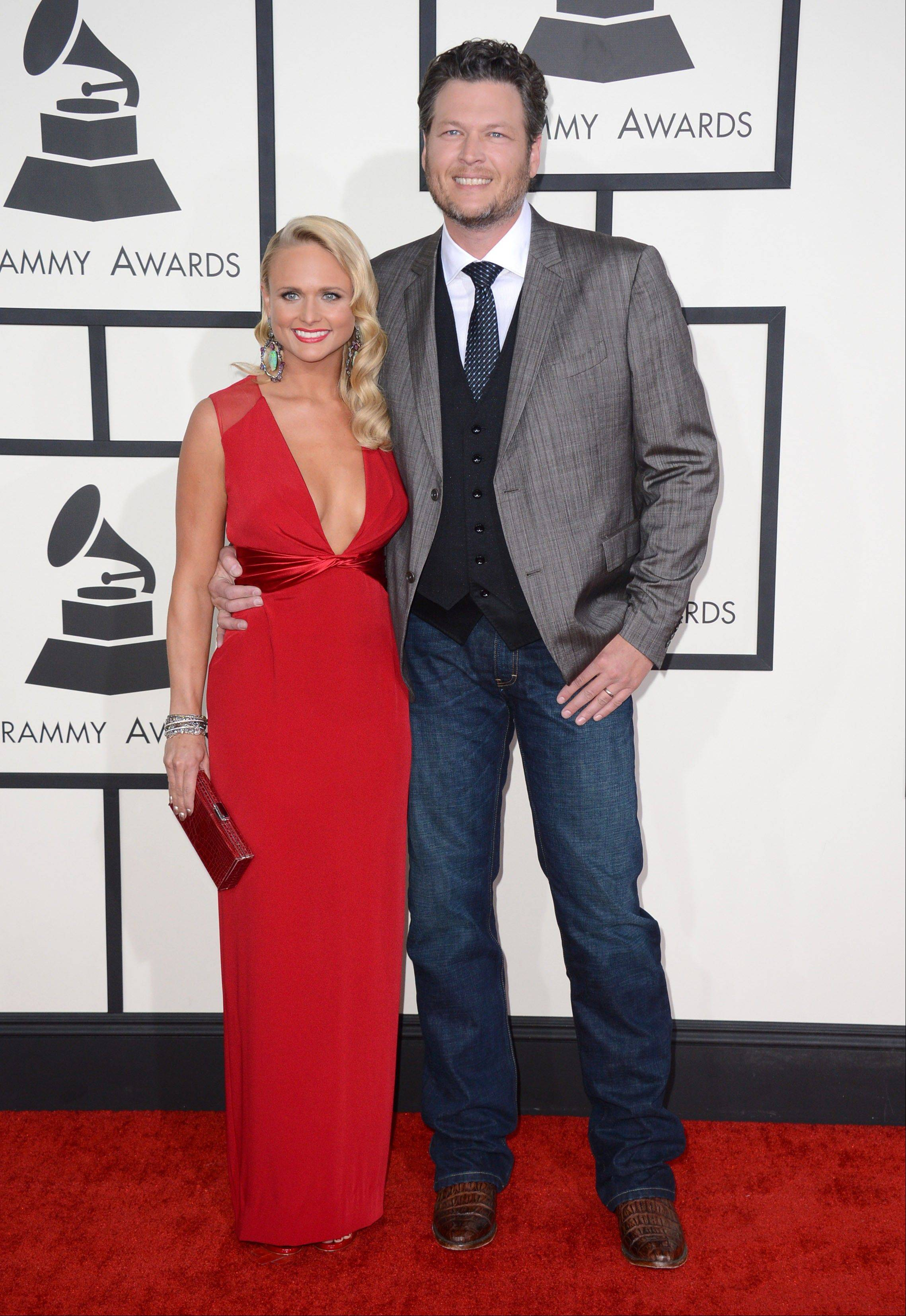 "Country singer Miranda Lambert walks the red carpet with her husband, singer and ""Voice"" judge Blake Shelton, at the 56th annual Grammy Awards at Staples Center on Sunday in Los Angeles."