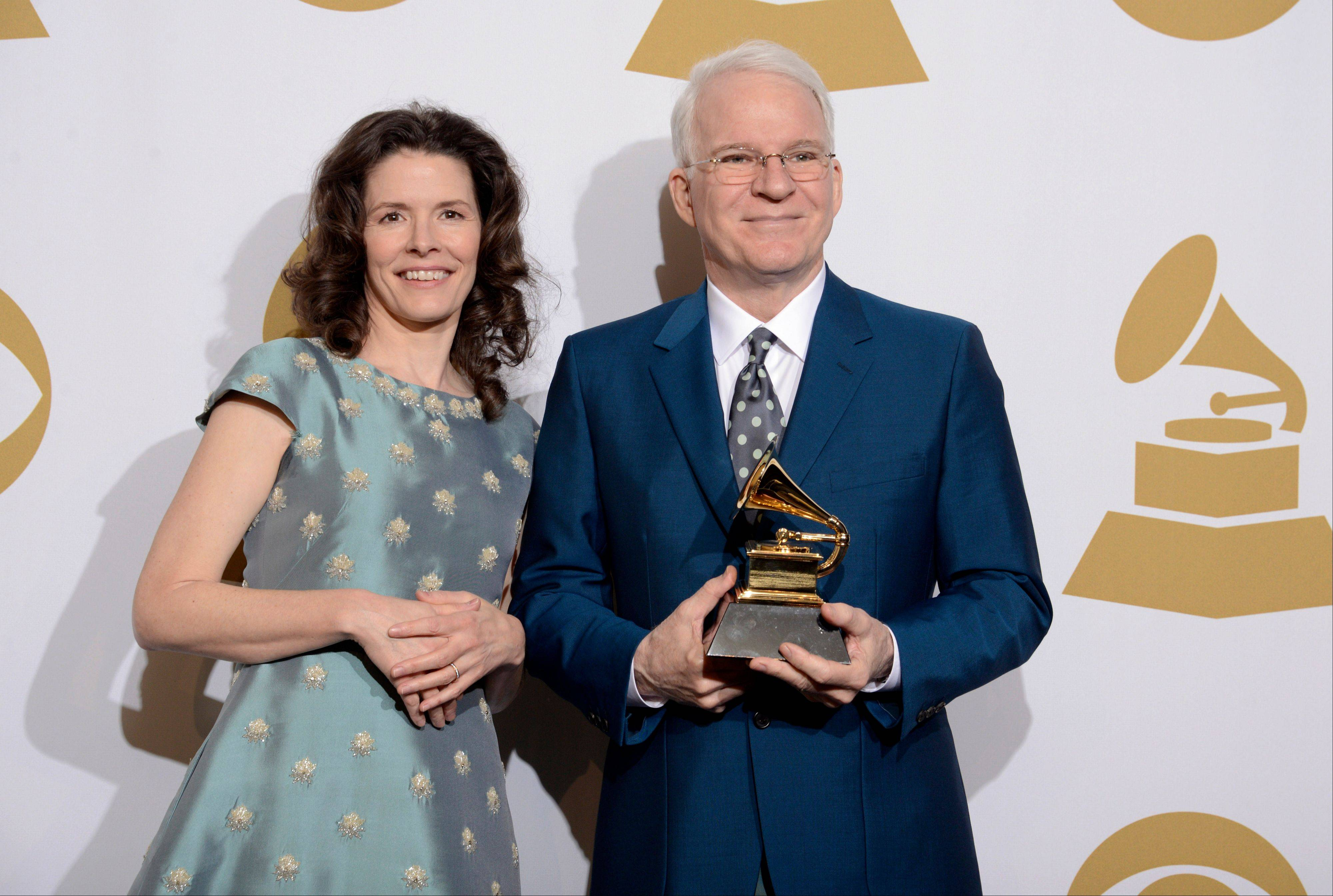 "Edie Brickell, left, and Steve Martin pose in the press room with the award for best American roots song, ""Love Has Come For You."""