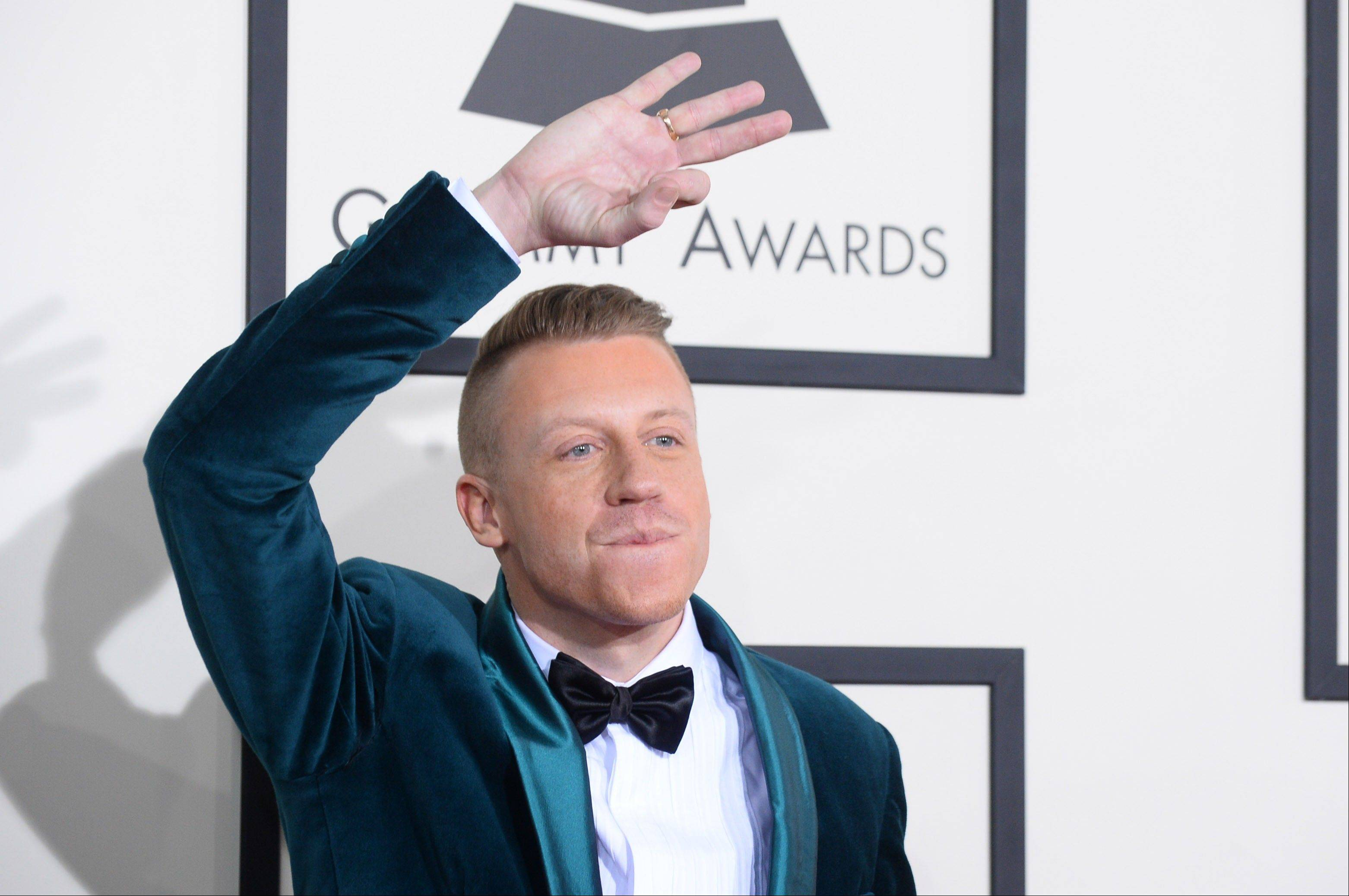 Macklemore arrives at the 56th annual GRAMMY Awards at Staples Center on Sunday.