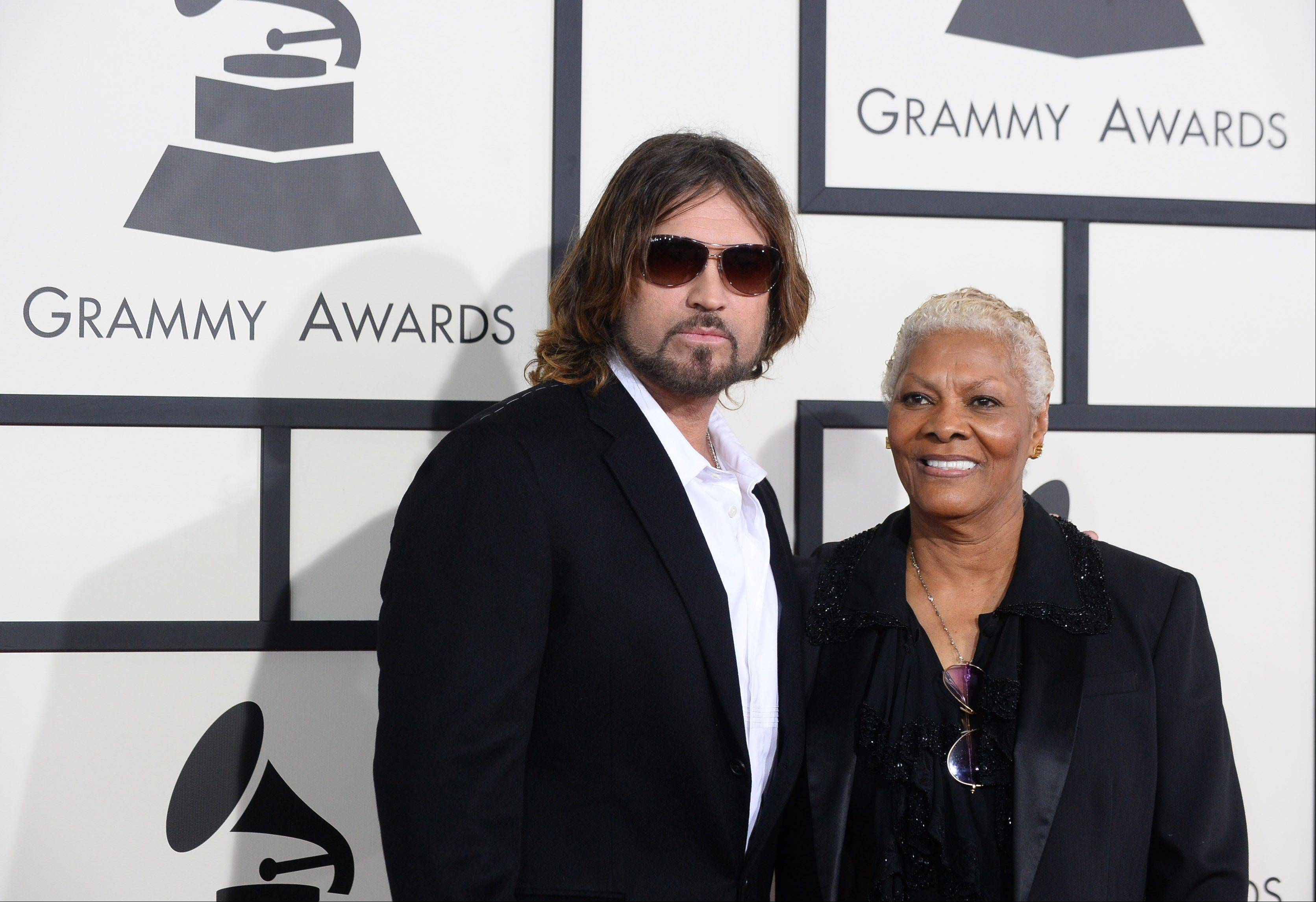 Billy Ray Cyrus and Dionne Warwick arrive at the 56th annual Grammy Awards.