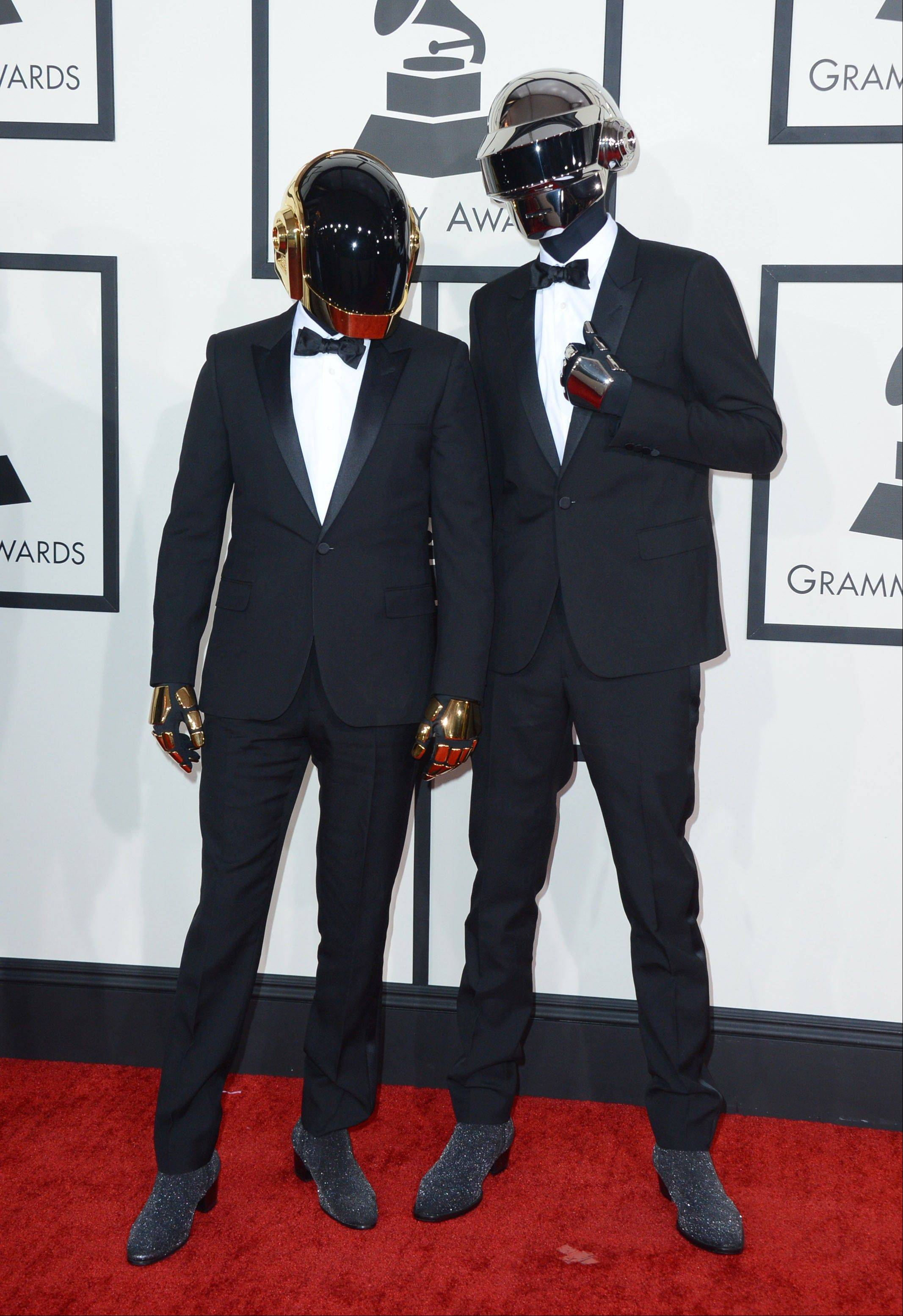 Daft Punk arrives at the 56th annual Grammy Awards at Staples Center on Sunday.